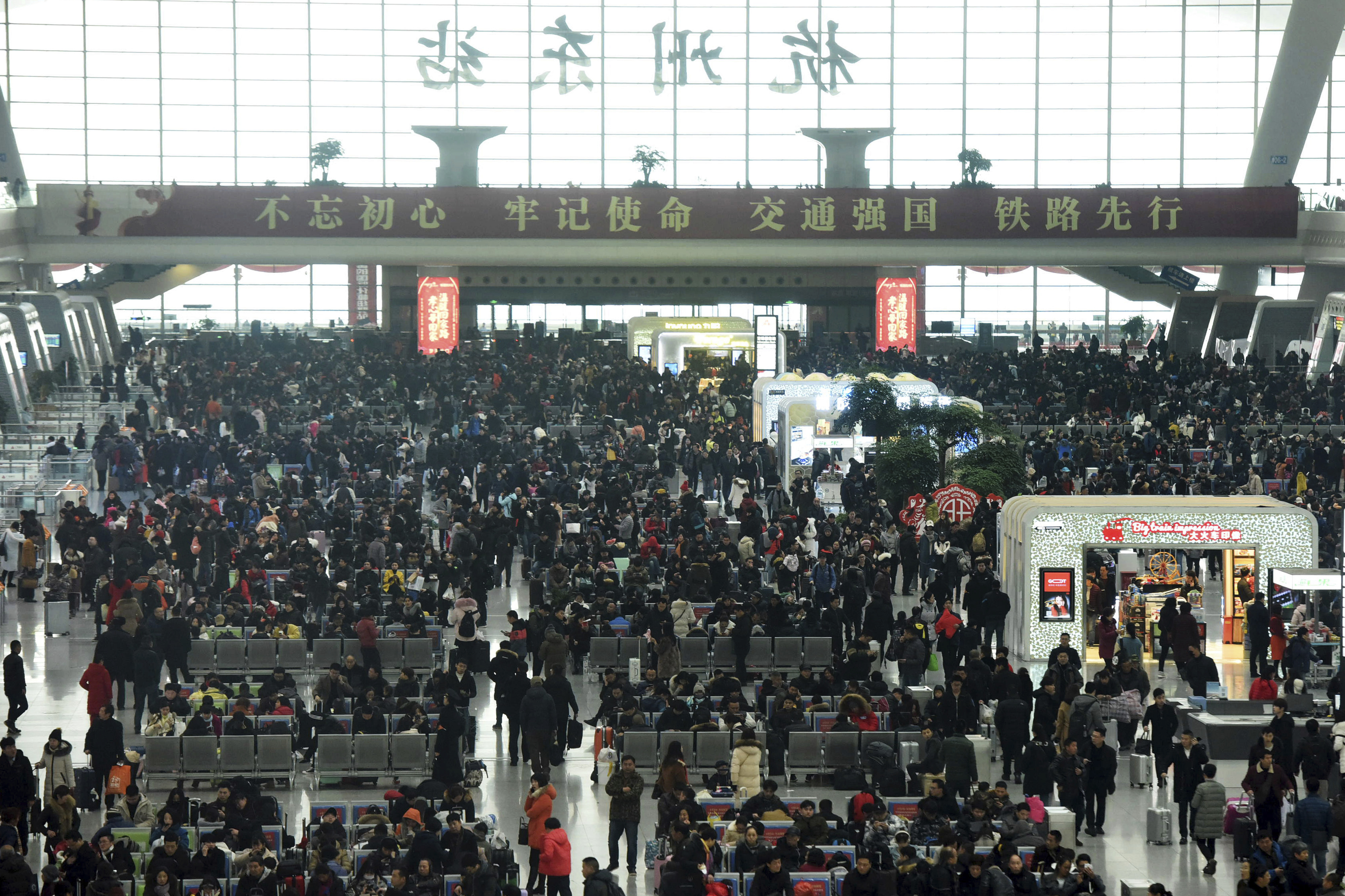 Passengers wait for their trains at the Hangzhou East Railway (Chinatopix/AP)