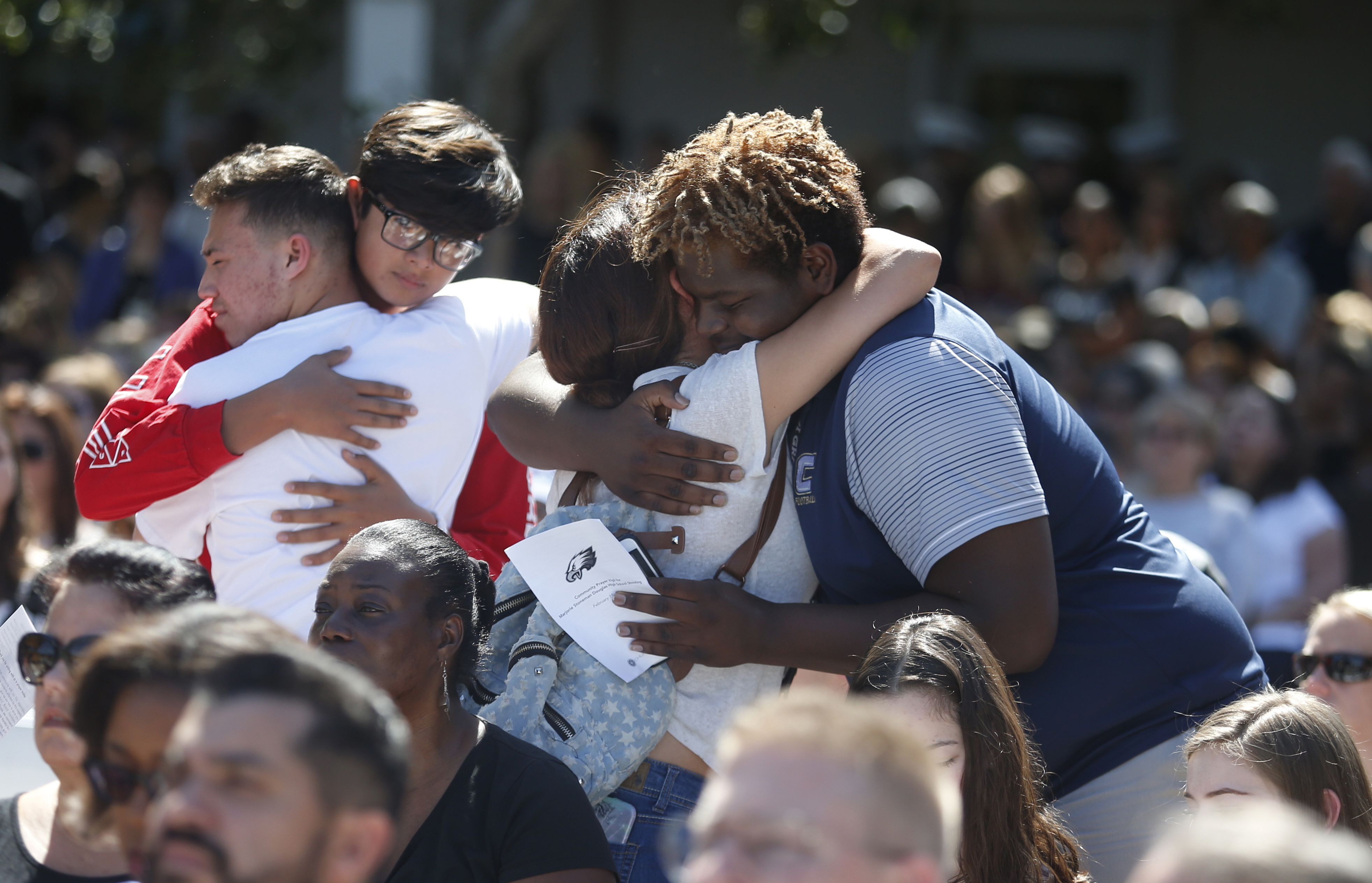 People comfort each other at a prayer vigil for the victims of the shooting (Wilfredo Lee/AP)