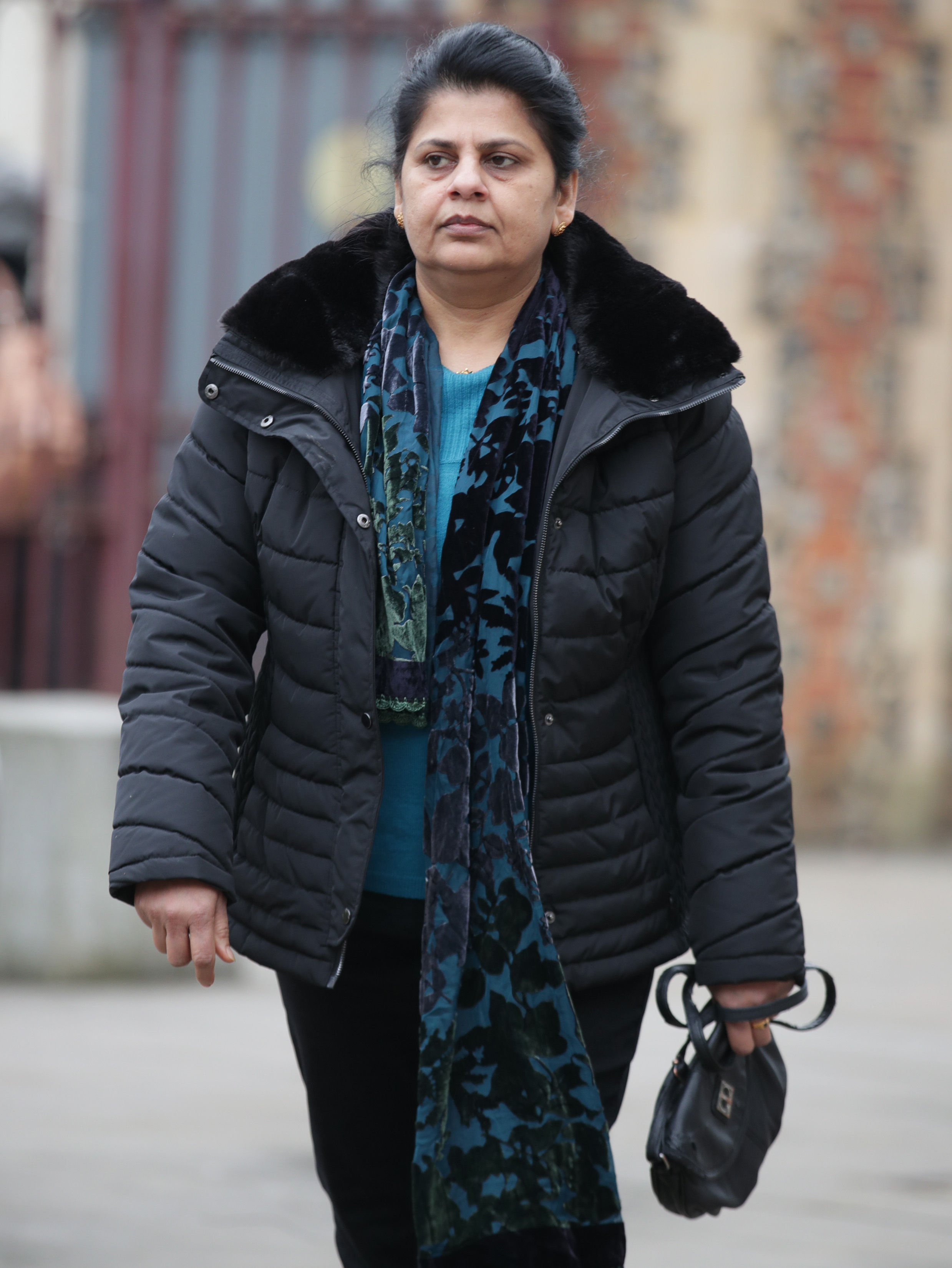 Ancy Joseph, the widow of Cyriac Joseph, arriving at Reading Crown Court (Yui Mok/PA)