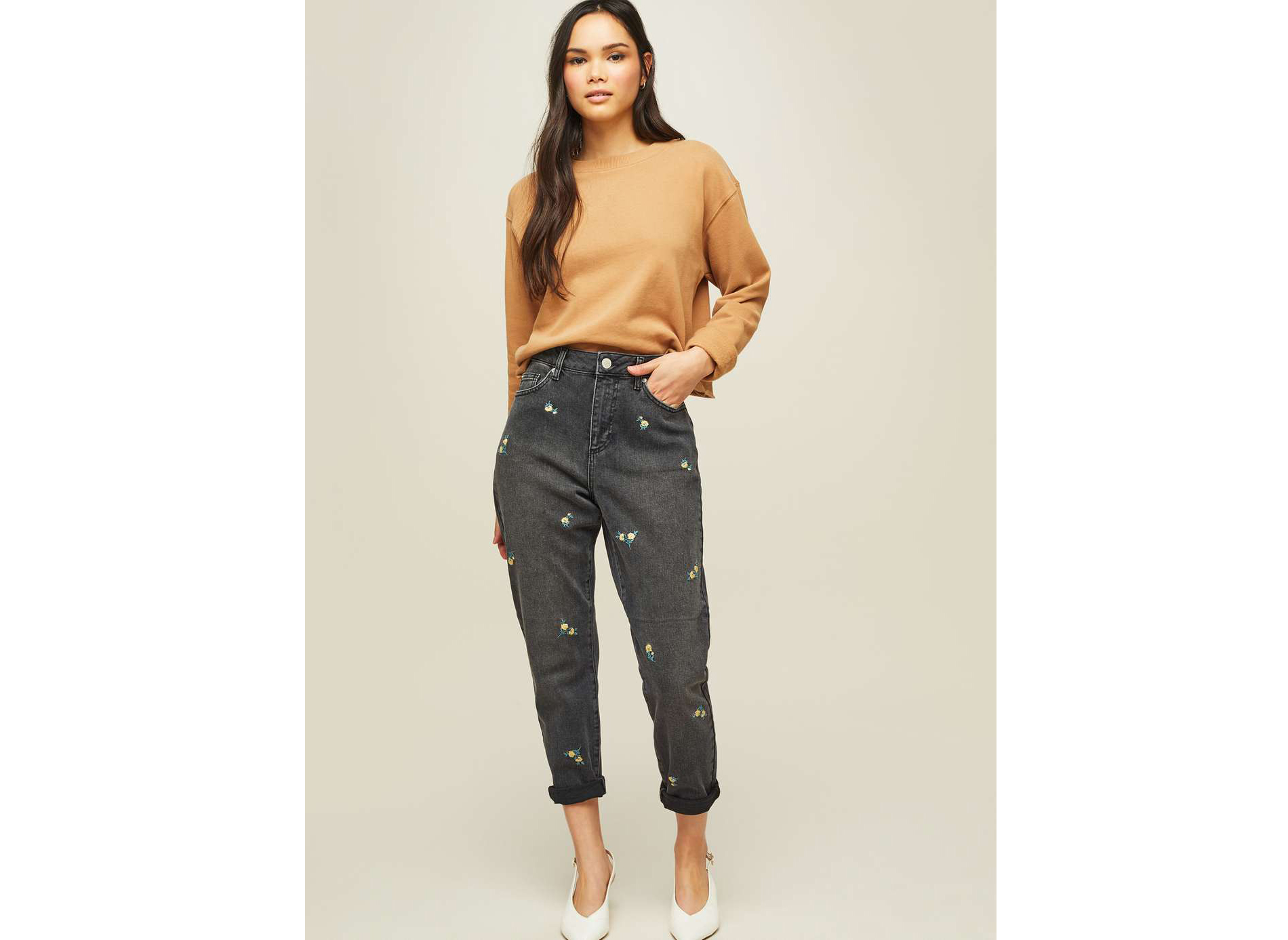 model wearing Miss Selfridge Camel Cropped Sweatshirt and Mom Black Ditsy Embroidered Jeans