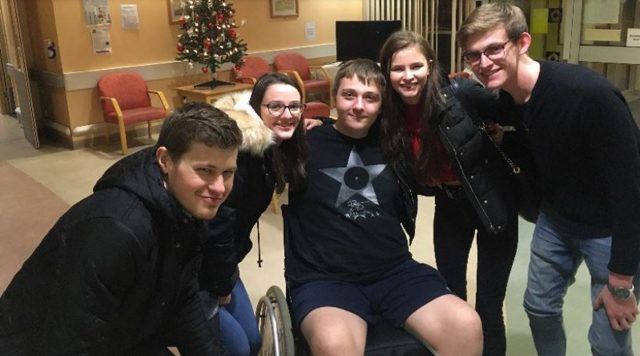 Ross with friends in hospital (Collect/PA Real Life)