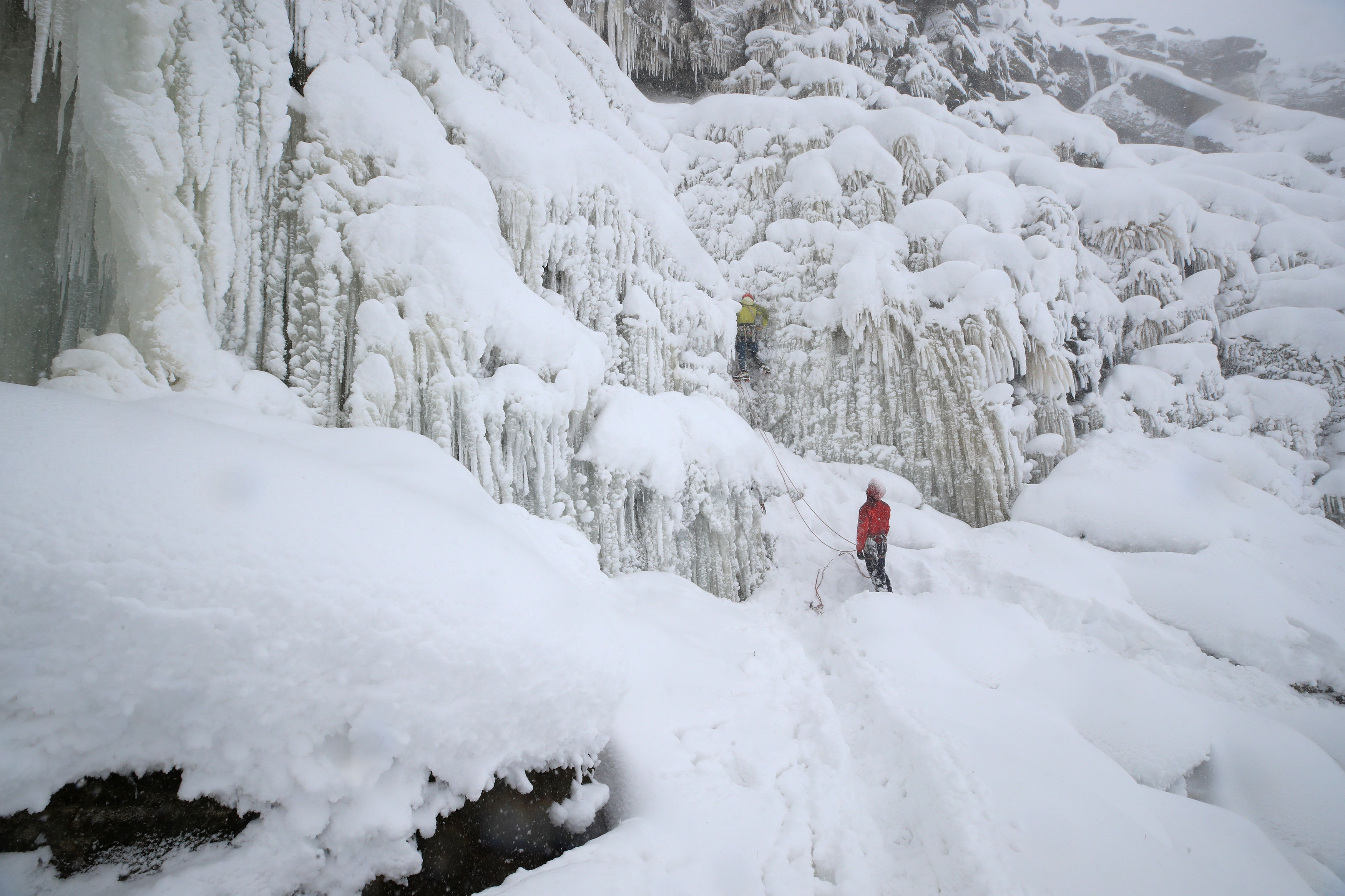 Ice climbers at Kinder Downfall, High Peak in Derbyshire