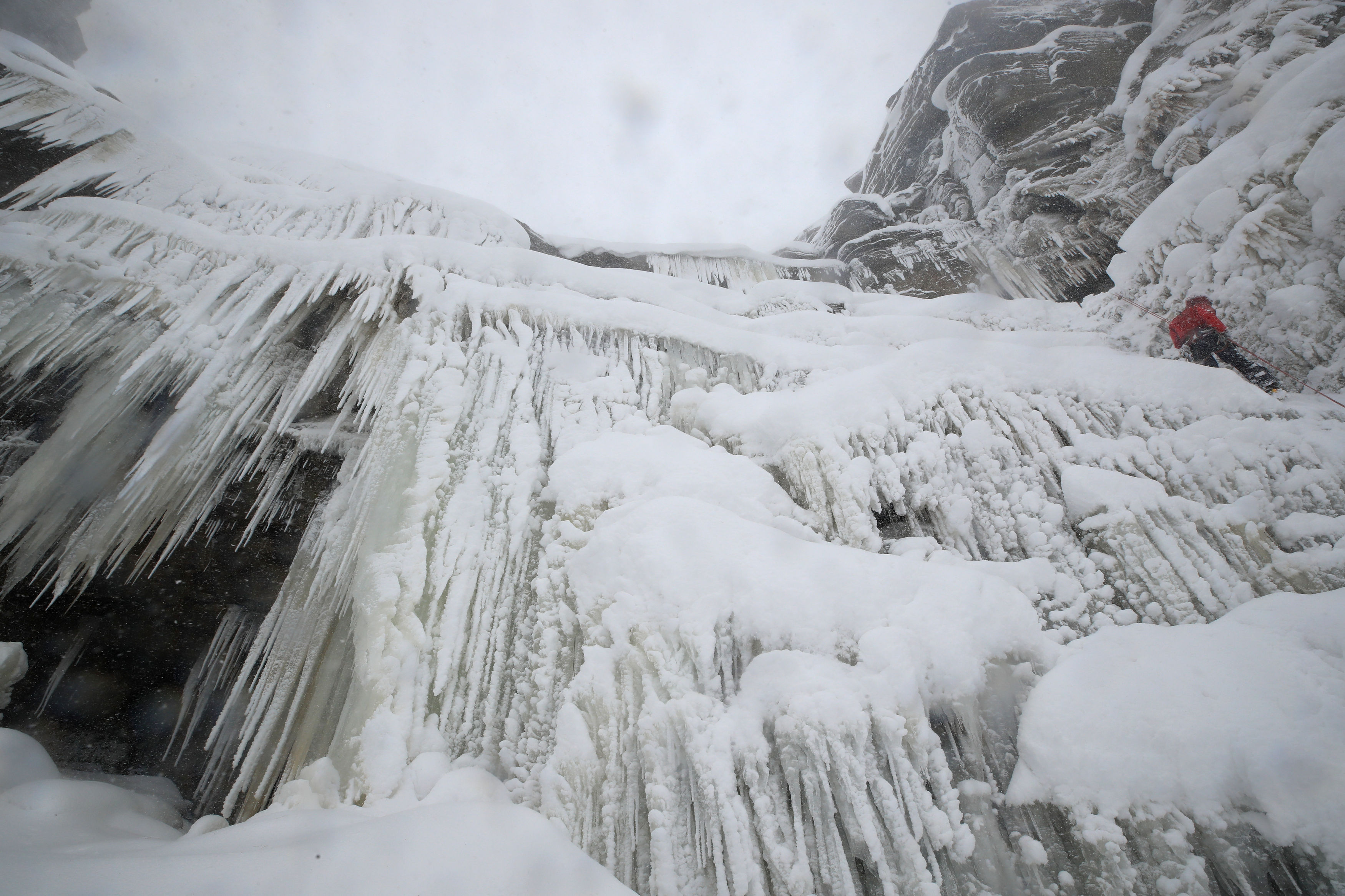 Ice climbers on the downfall at Kinder Downfall, High Peak in Derbyshire