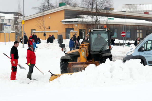 A plough was brought in to help clear the area around the school for pupils (Andrew Milligan/PA)