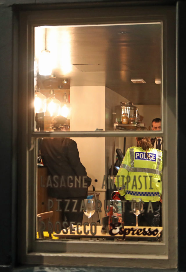 Police inside a Zizzi restaurant in Salisbury which has been closed in connection with an incident in which former Russian double agent Sergei Skripal was left critically ill by exposure to an unknown substance. (Steve Parsons/PA)