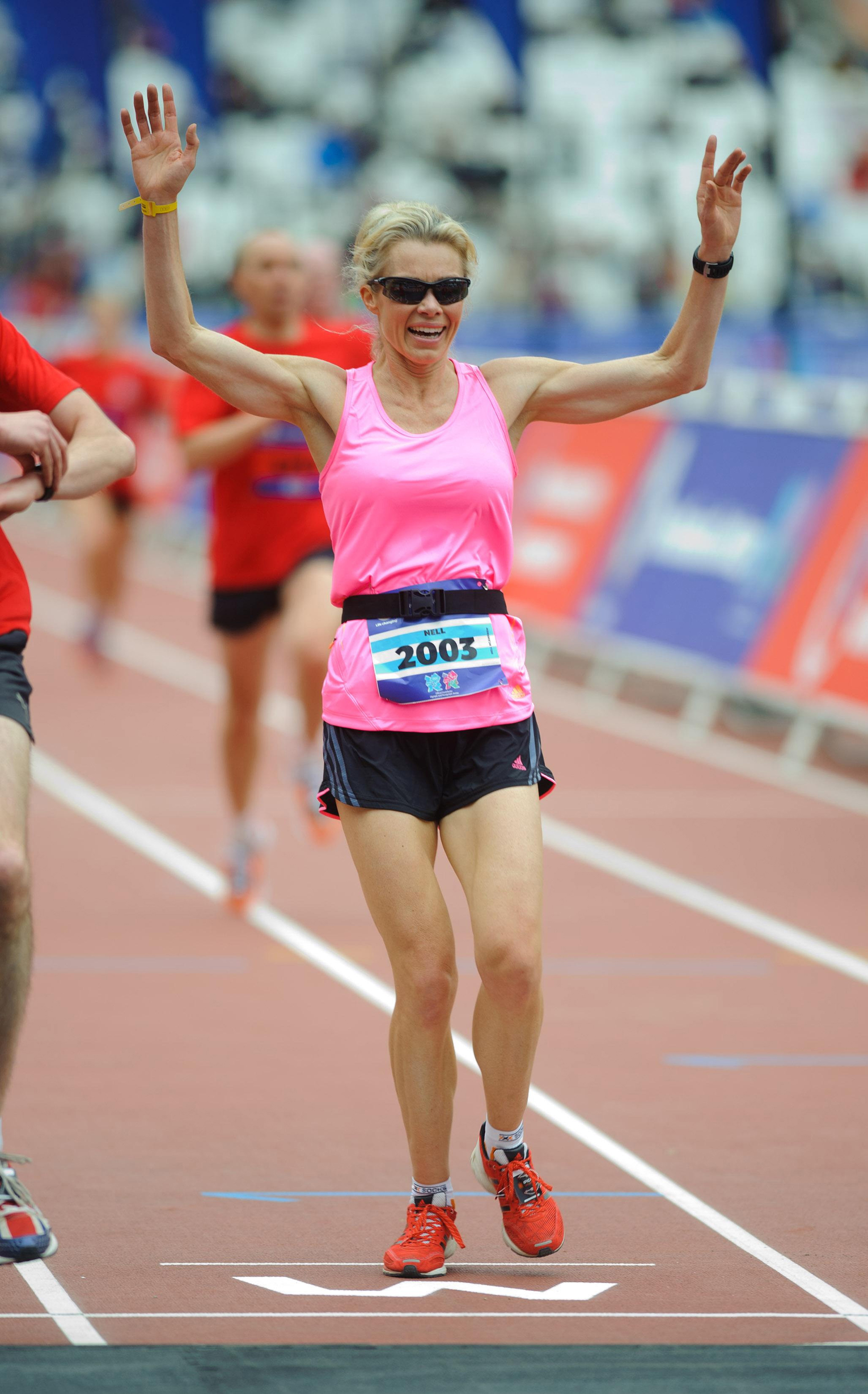 Nell McAndrew coming first in the ladies National Lottery Olympic Park run, a five mile circuit around the Olympic site in Stratford East London in 2012. (Matt Crossick/PA)
