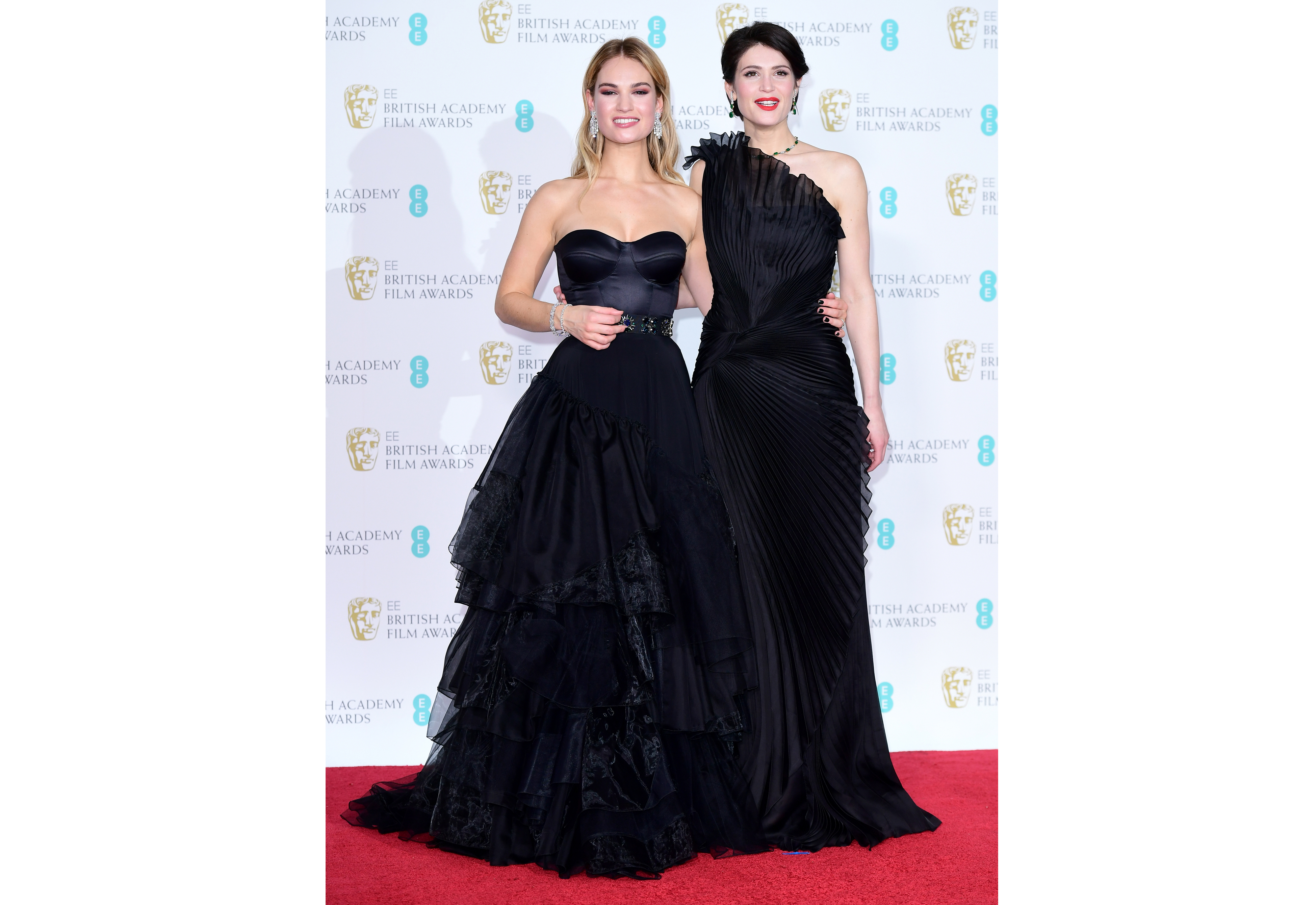 Lily James (left) and Gemma Arterton in the press room at the Baftas 2017