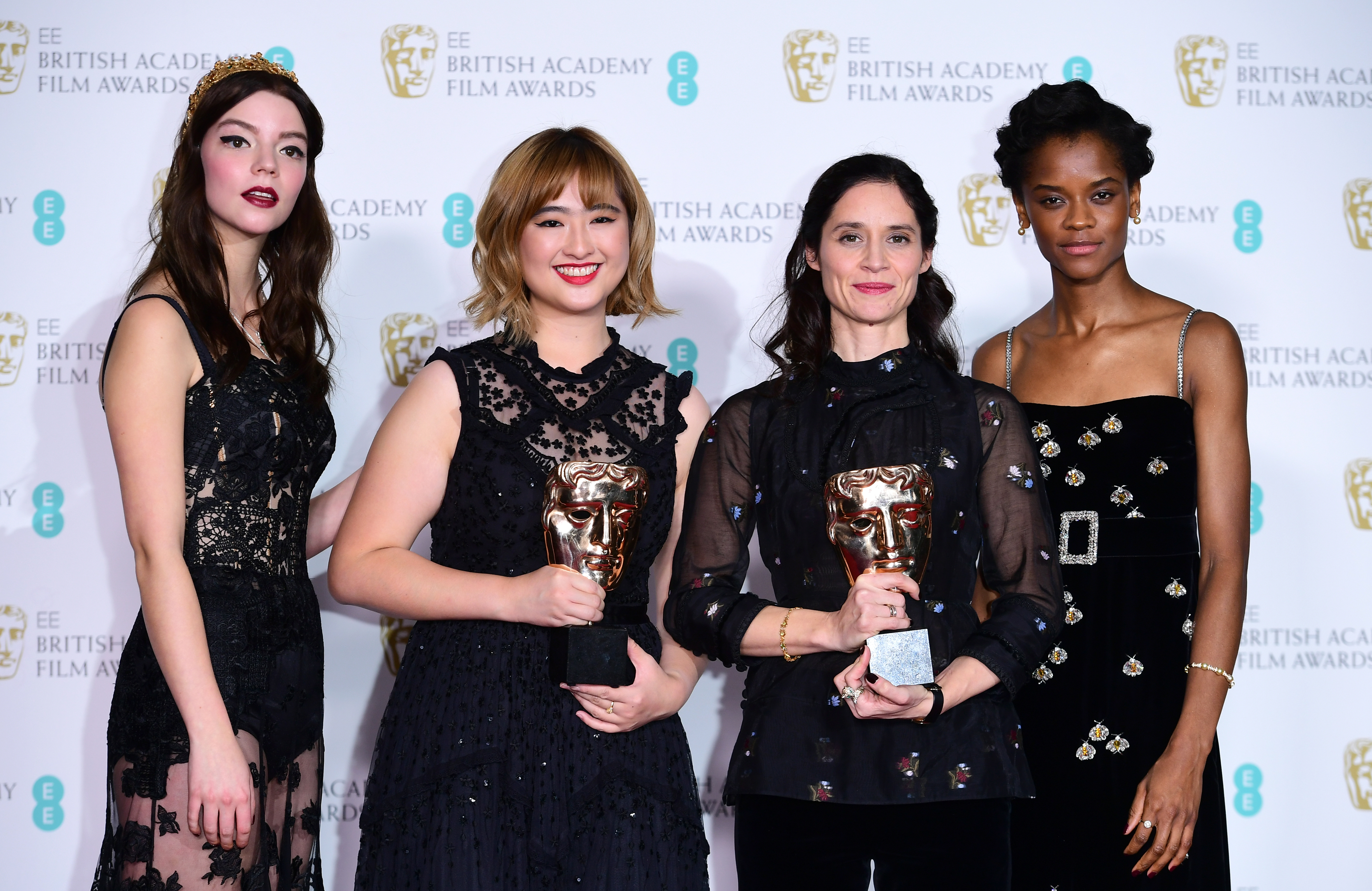 Anya Joy Taylor (left) and Letitia Right (right) present the BAFTA for British Short Animation to Ser En Low (second left) and Paloma Baeza in the press room at the EE British Academy Film Awards held at the 2017 Baftas