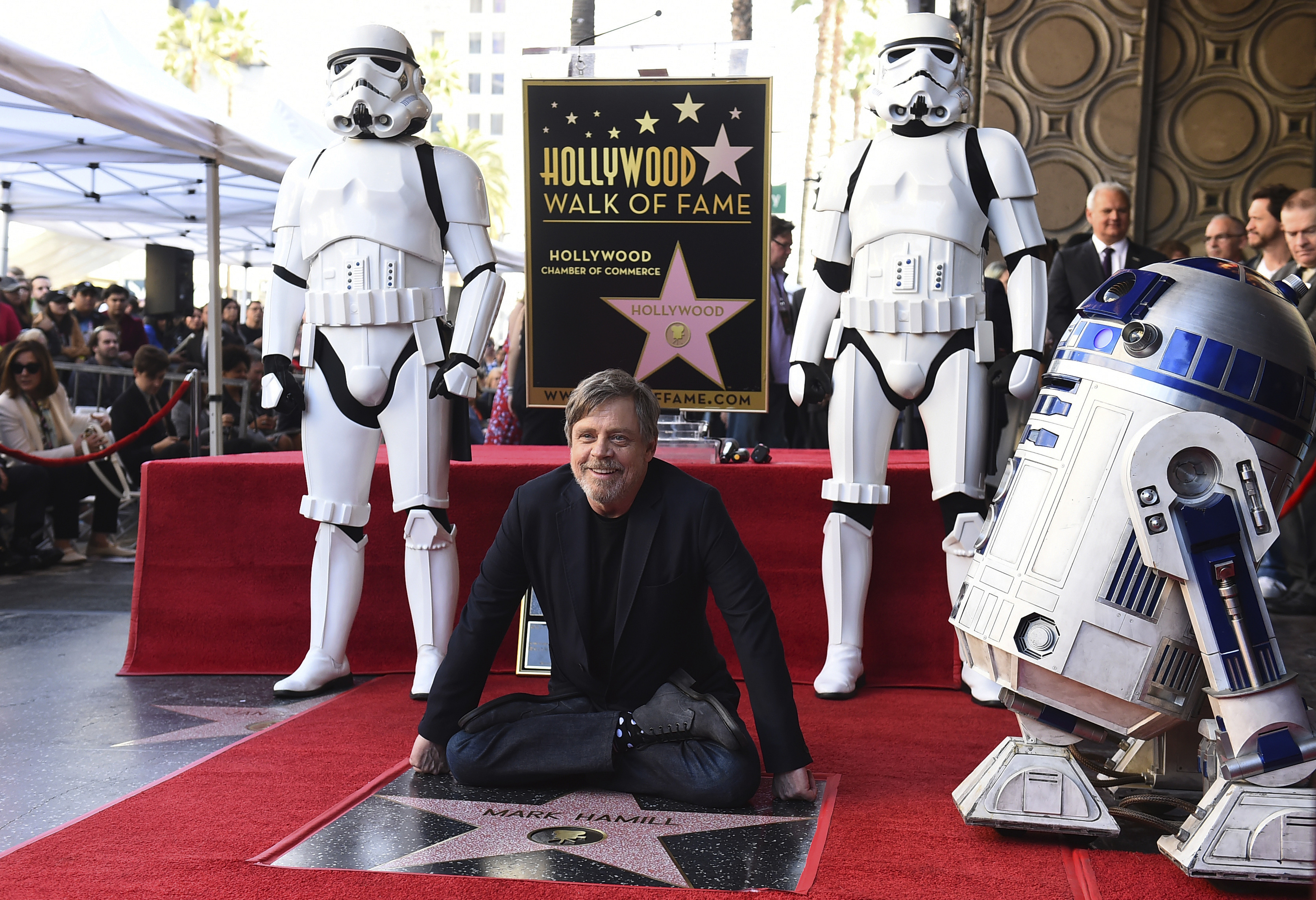 Mark Hamill sits by his star