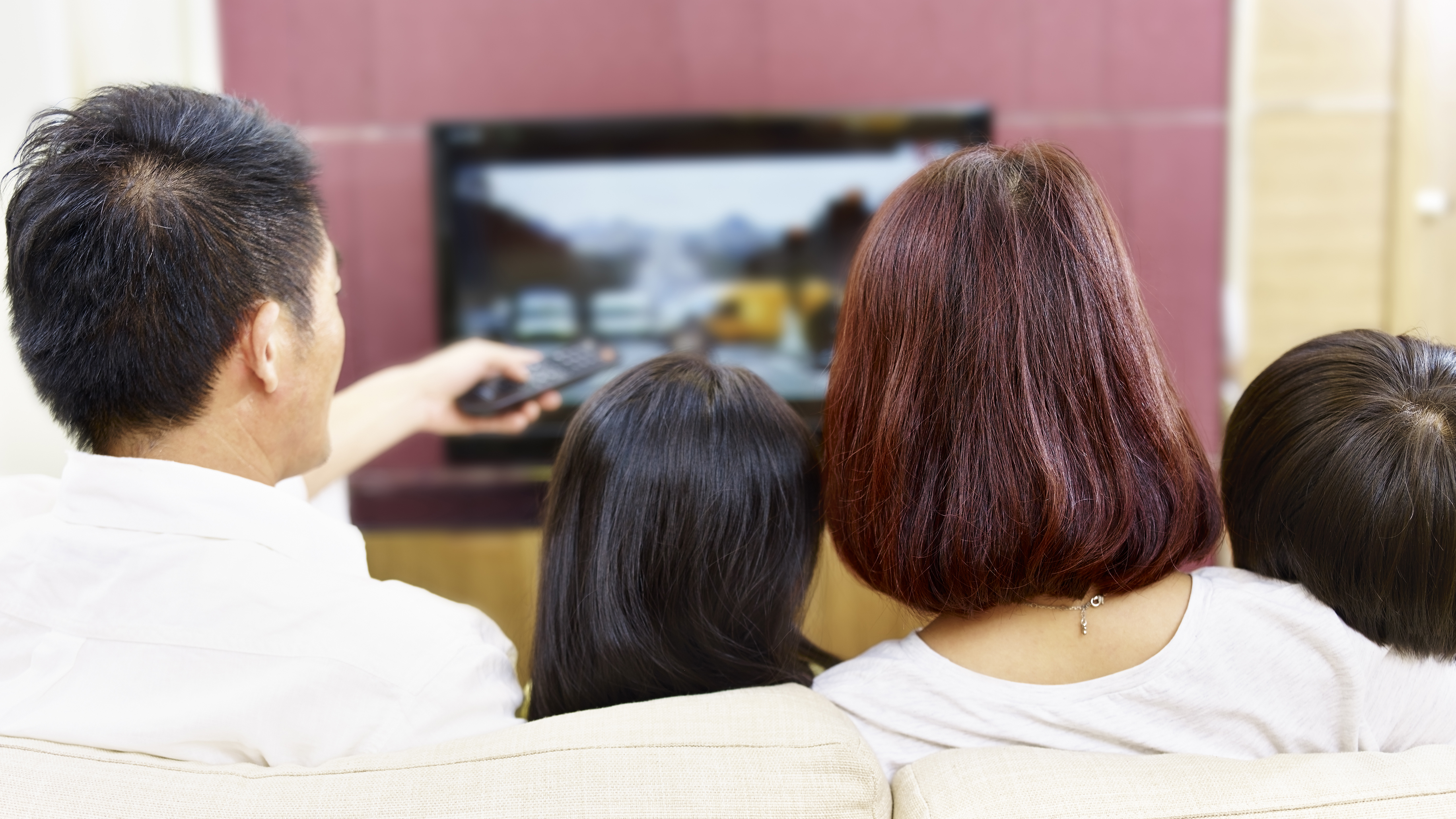 Family watching TV and using a personal on demand TV service