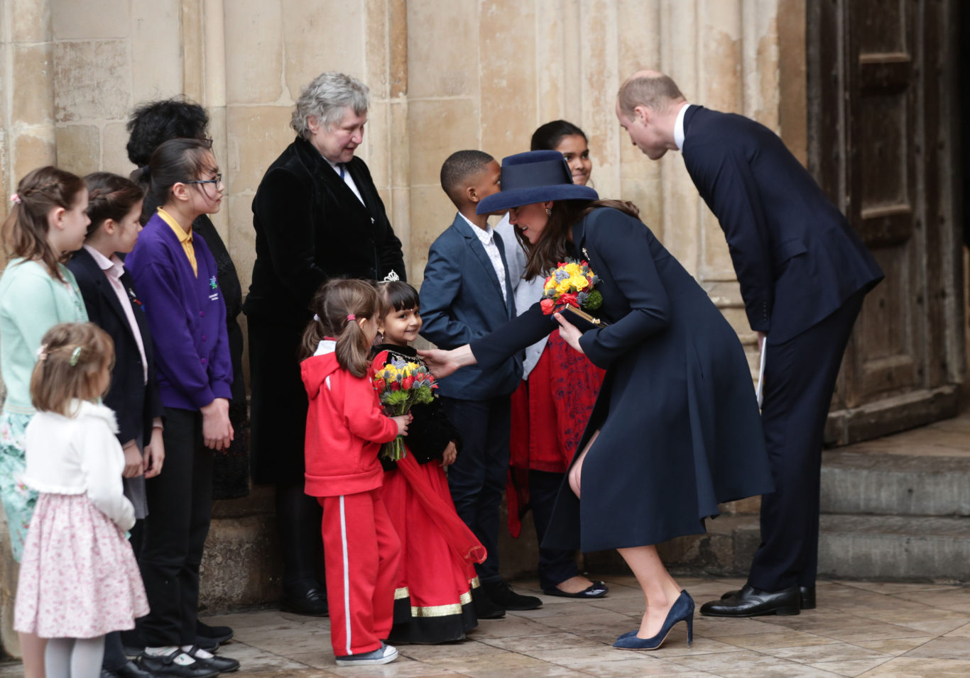 The Duke and Duchess of Cambridge talk to children as they leave Westminster Abbey (Yui Mok/PA)