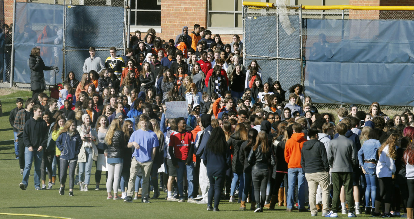 Students from Douglas Freeman High School walk out of school to protest gun violence in Richmond, Virginia ( Steve Helber/AP)