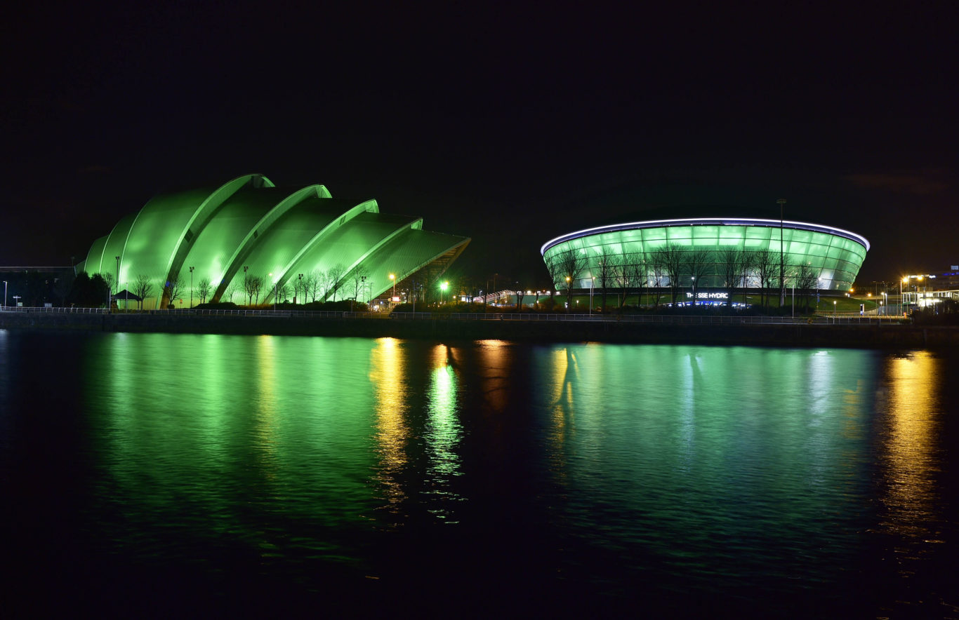 The SEC Armadillo and SSE Hydro are illuminated green in Glasgow by Tourism Ireland to mark St Patrick's Day (Sandy Young/PA)