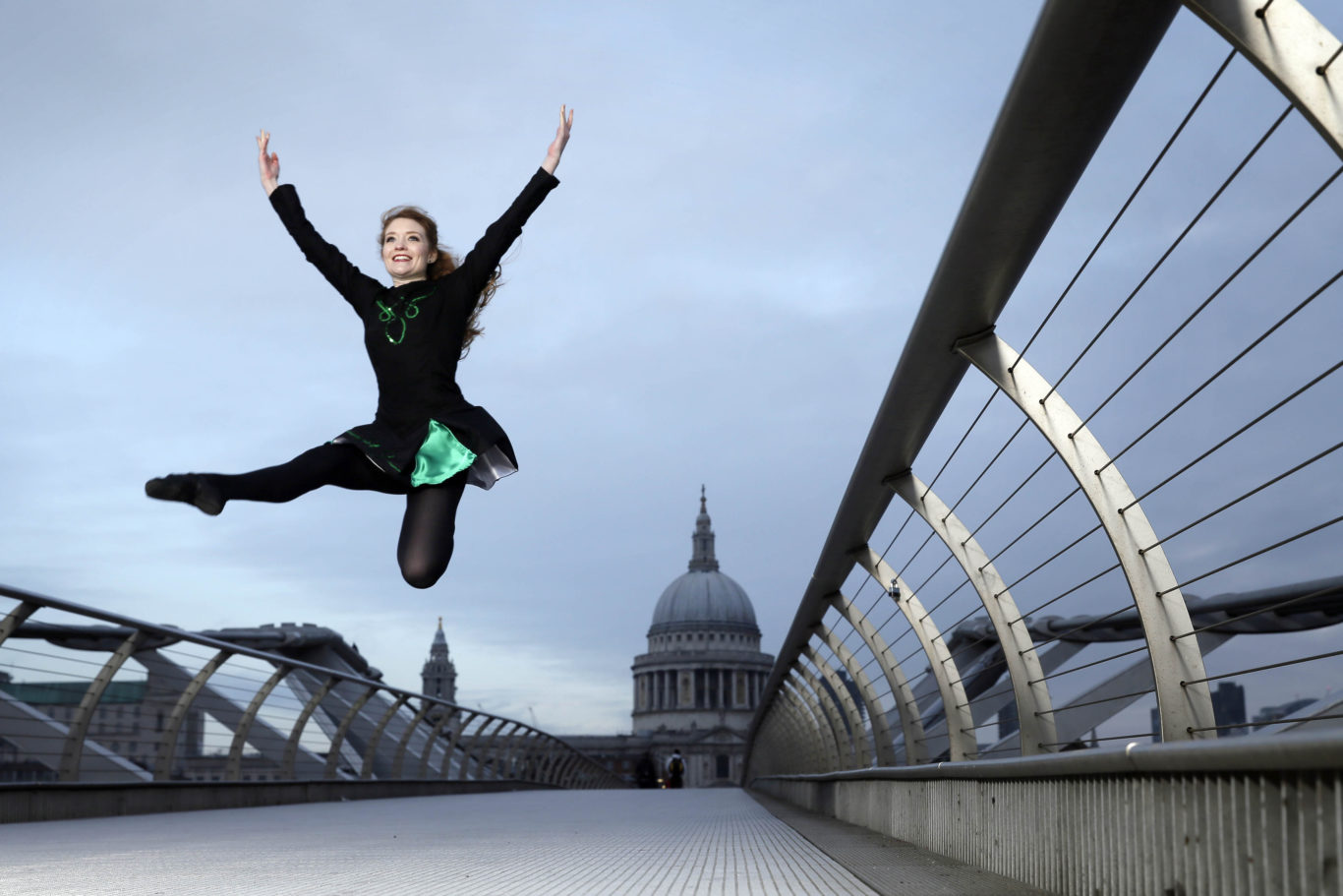 Irish dancers perform on London's Millennium Bridge (Tim Ireland/PA)