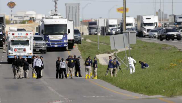 Officials at the scene in Round Rock, Texas (Eric Gay/AP)