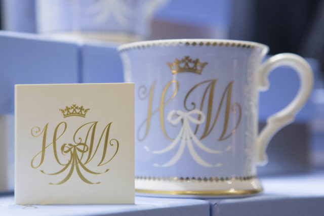 The matching monogram on the card and tankard (Rick Findler/PA)