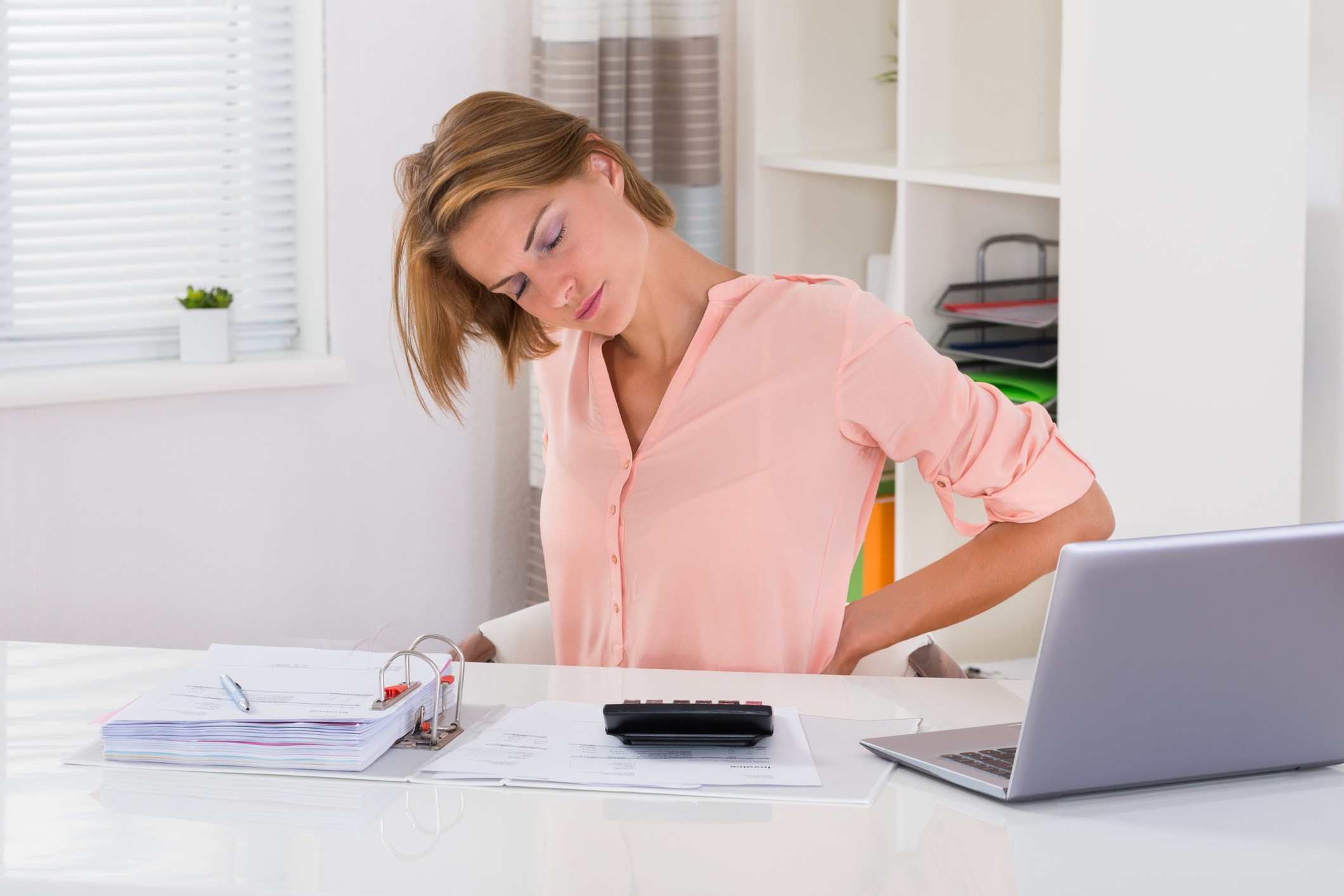 Ensure you have a good posture if you sit at a desk all day (Thinkstock/PA)