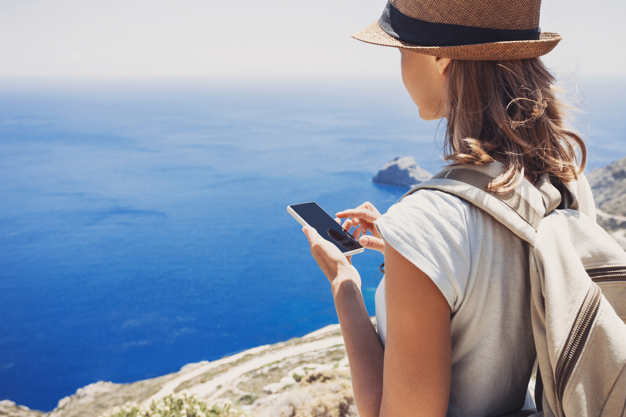Woman using her phone on holiday (Thinkstock/PA)
