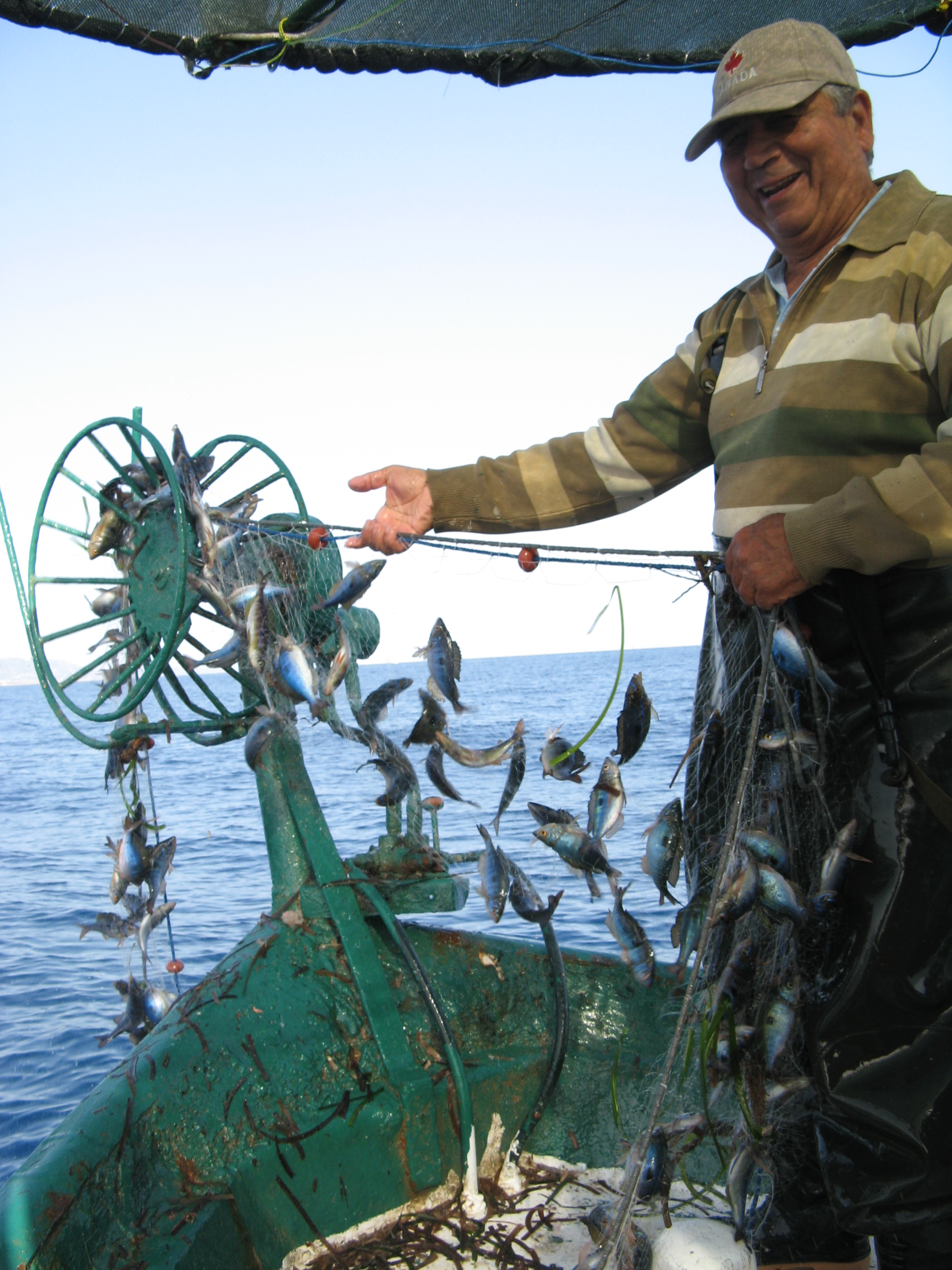 A fisherman off the coast of northern Cyprus with his catch (Robin Snape/University of Exeter/PA).