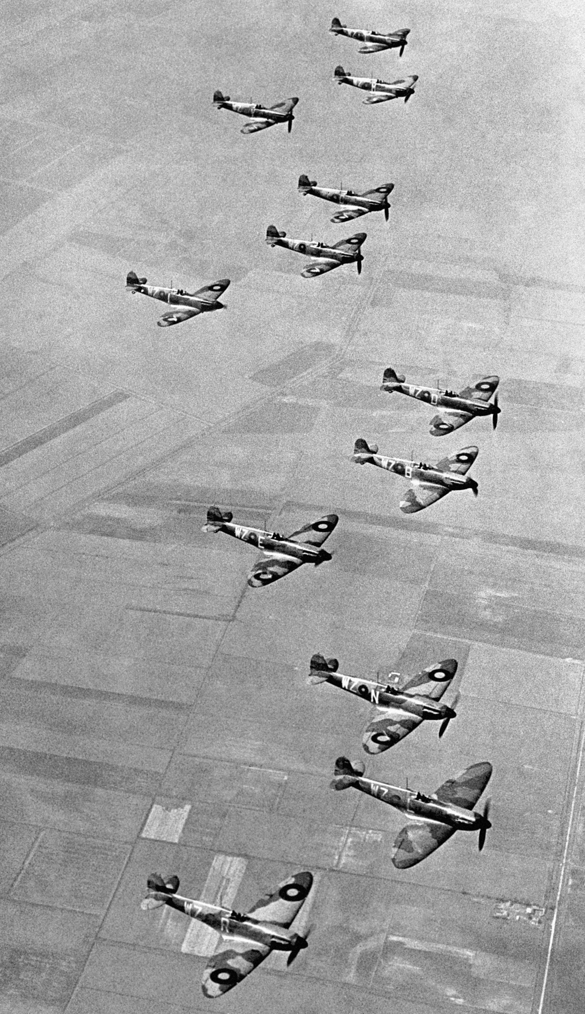 No19 Fighter Squadron, based at Duxford, Cambridgeshire, flying their two blade propeller Supermarine Spitfire aircraft in formation in 1939 (PA)