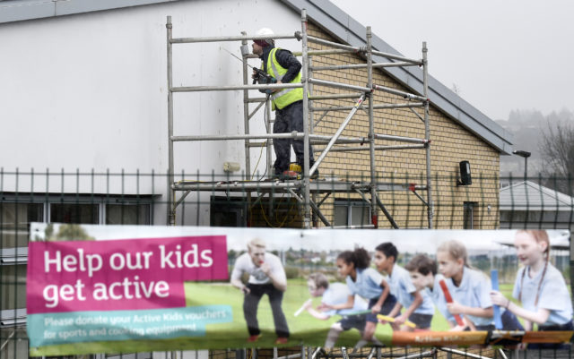 Workmen carrying out repairs at Oxgangs Primary School. (Jane Barlow/PA)