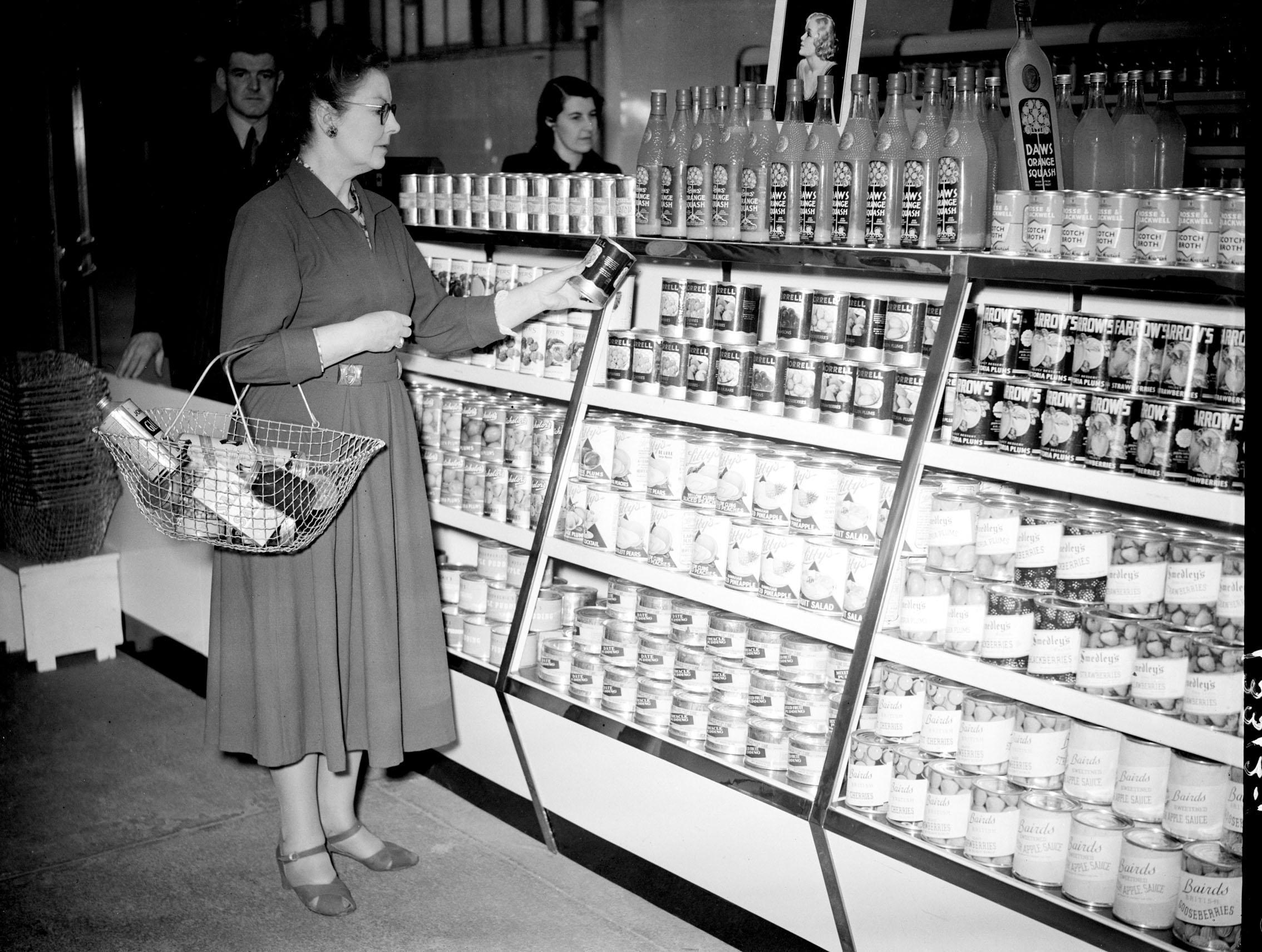 A customer pictured in a 'help yourself shop' in 1949 (PA Archive)