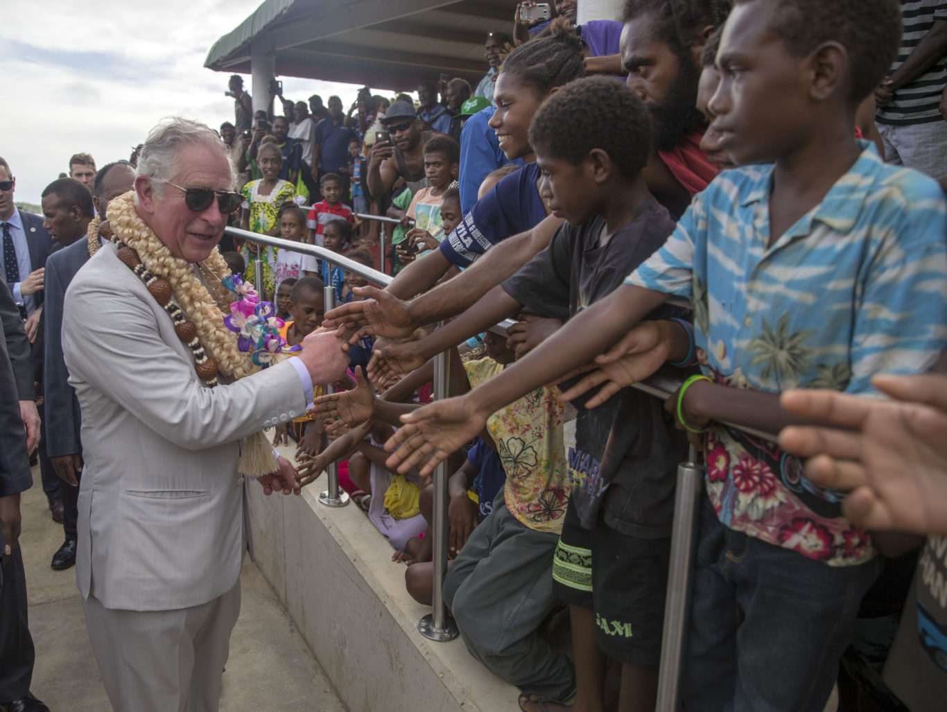 The Prince of Wales greets well-wishers during a visit to Haos blong Handikraf (Steve Parsons/PA)