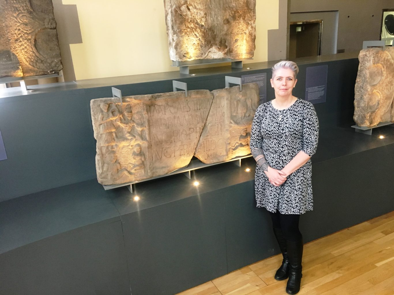 Dr Louisa Campbell with the Summerston distance stone from the Antonine Wall (University of Glasgow/PA)