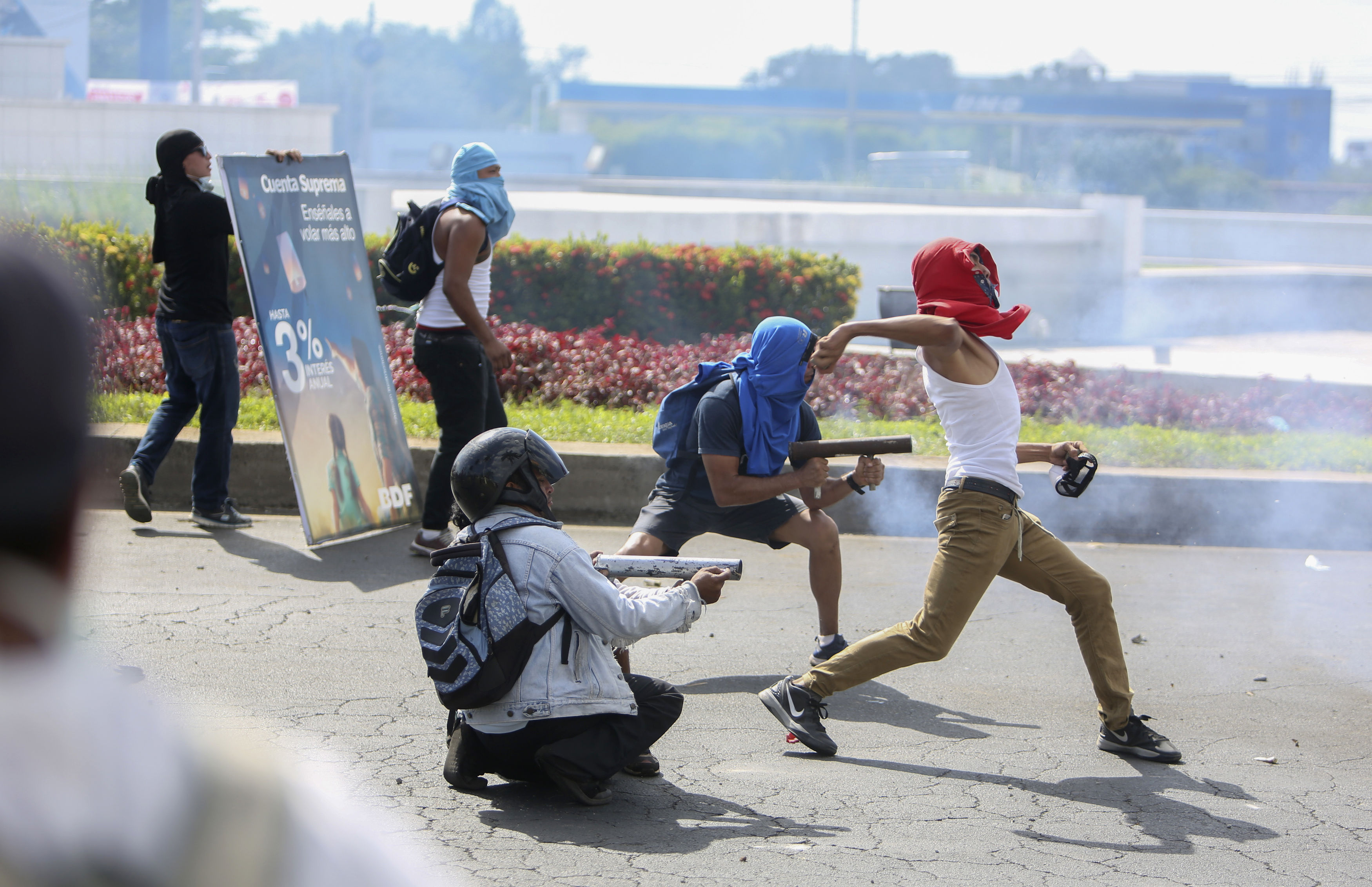 Masked protesters during a third day of violent clashes in Nicaragua (Alfredo Zuniga/AP)
