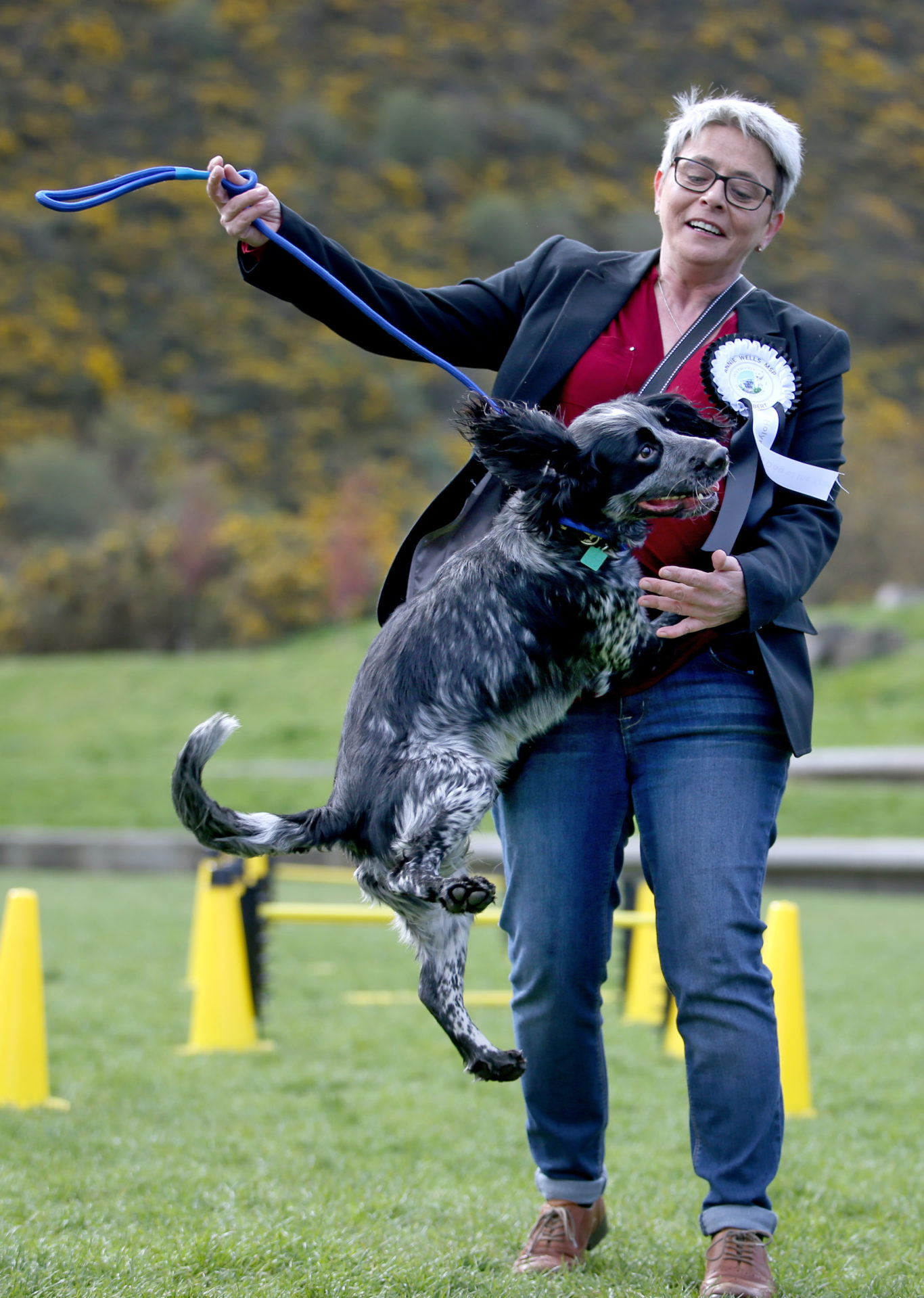 Politician Maurice Corry MSP and his dog Bobby tackle the obstacle course  (Jane Barlow/PA)