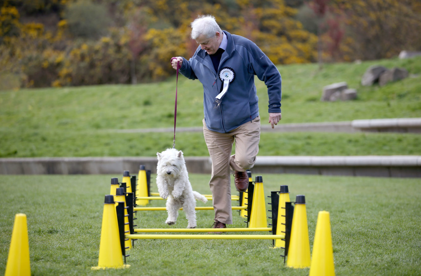 Nice form from Maurice Corry MSP and his dog Bobby (Jane Barlow/PA)