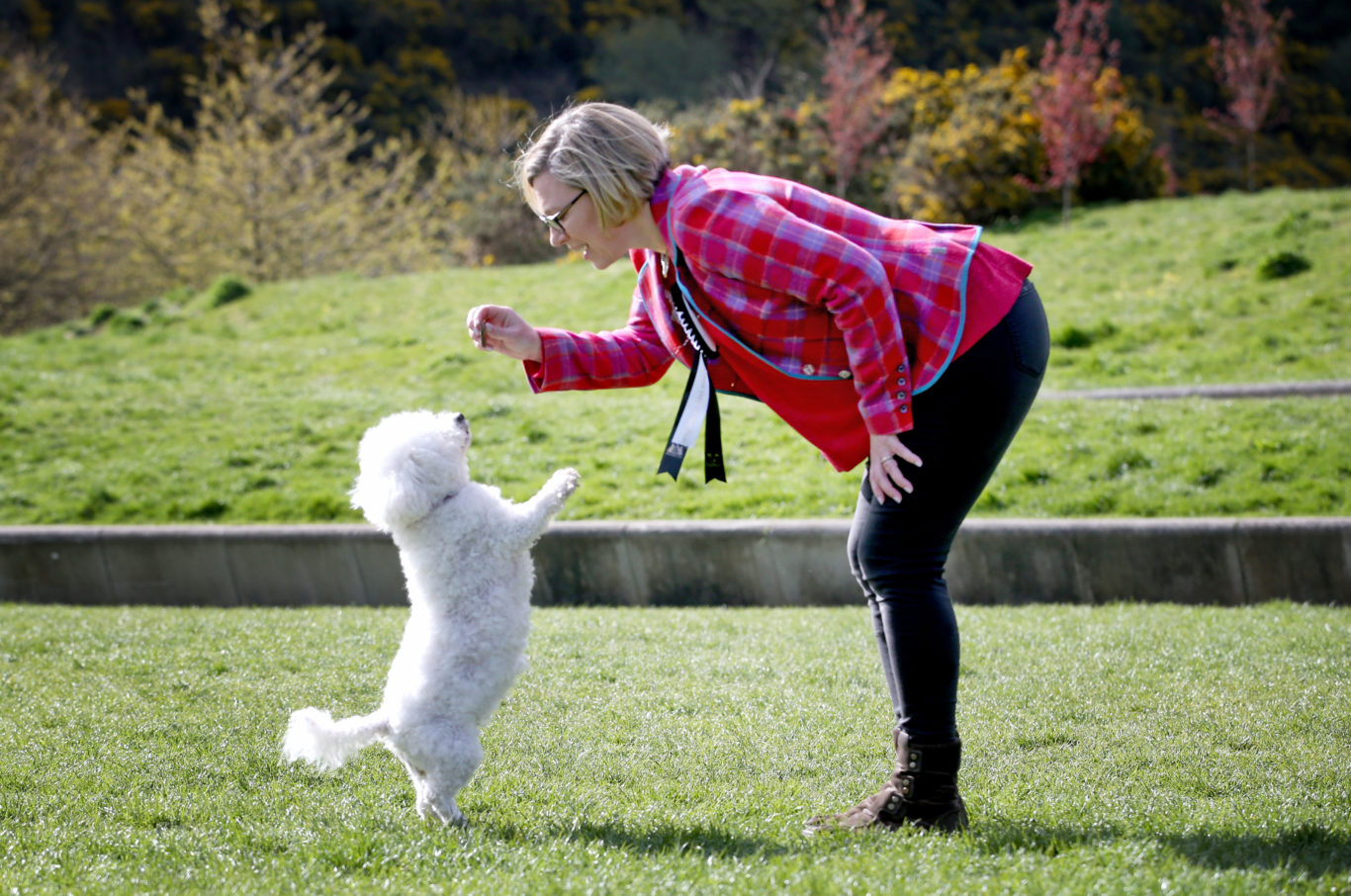 Gillian Martin MSP with her dog Lucy showing who's the boss (Jane Barlow/PA)