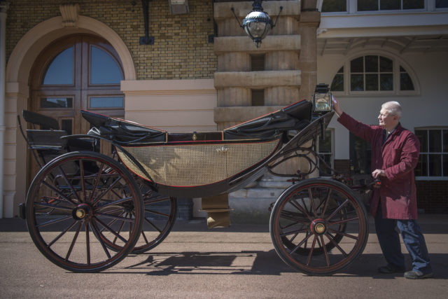 Senior carriage restorer Martin Oates polishes the Ascot Landau which will be used during Prince Harry and Meghan Markle's carriage procession. (Victoria Jones/PA Wire)