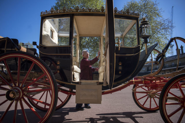 The Scottish State Coach, being cleaned by senior carriage restorer Martin Oates, will be used by Harry and his fiancee if it rains during their carriage procession. (Victoria Jones/PA Wire)