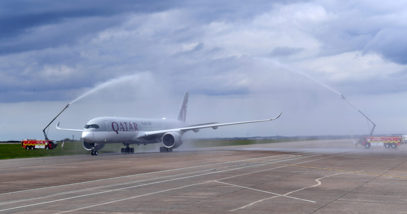 The aircraft is given a water cannon salute (Qatar Airways/PA)