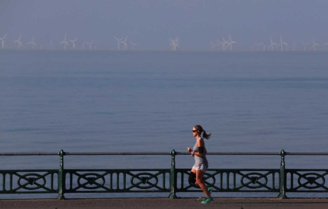 A jogger on Brighton seafront as the early May Bank Holiday Monday is forecast to be the hottest since records began (Steve Parsons/PA)