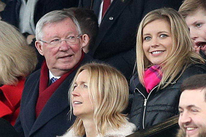 Riley with Sir Alex Ferguson during a match at Old Trafford in March