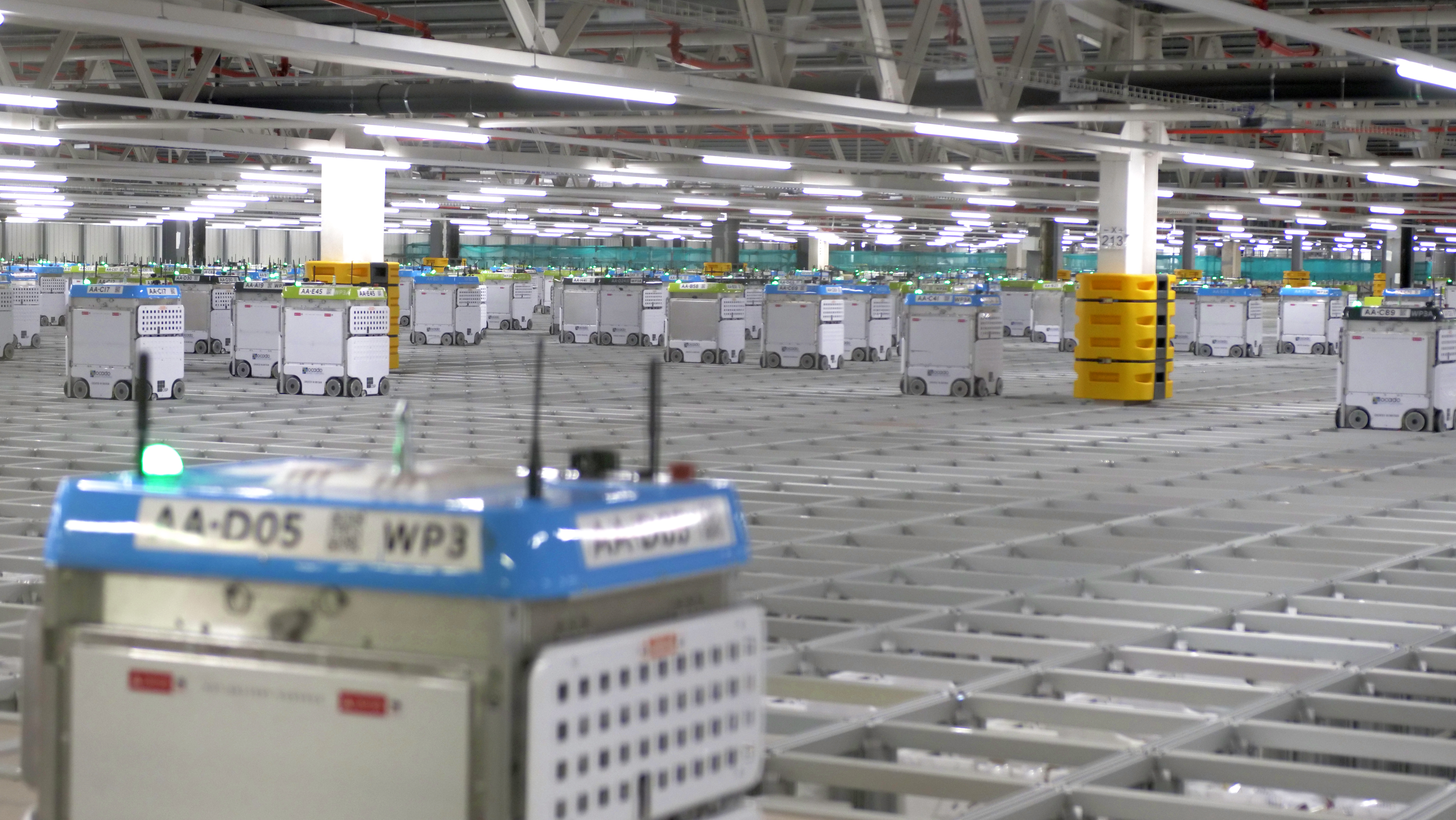 Watch Ocado robots pick groceries in a supermarket warehouse