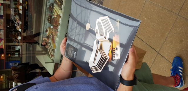 An Arctic Monkeys clutches a limited gold vinyl edition version of the band's new album.