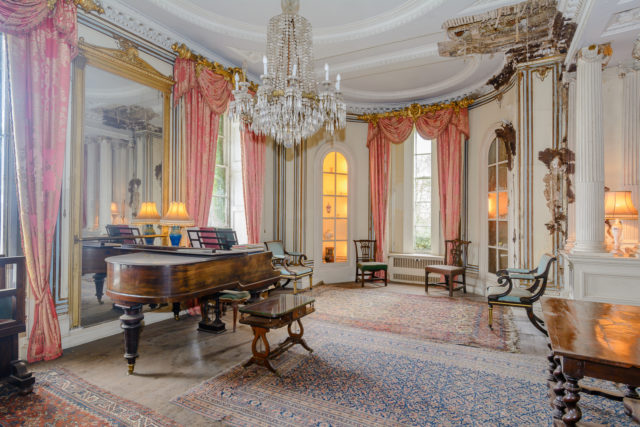 The eight-bedroom mansion boasts large rooms, two kitchens, one described as being in