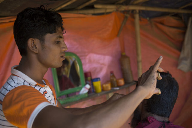 Mohammed Sayed, 20, a barber in Myanmar, who has continued cutting hair in the camps (AJ Ghani/British Red Cross)