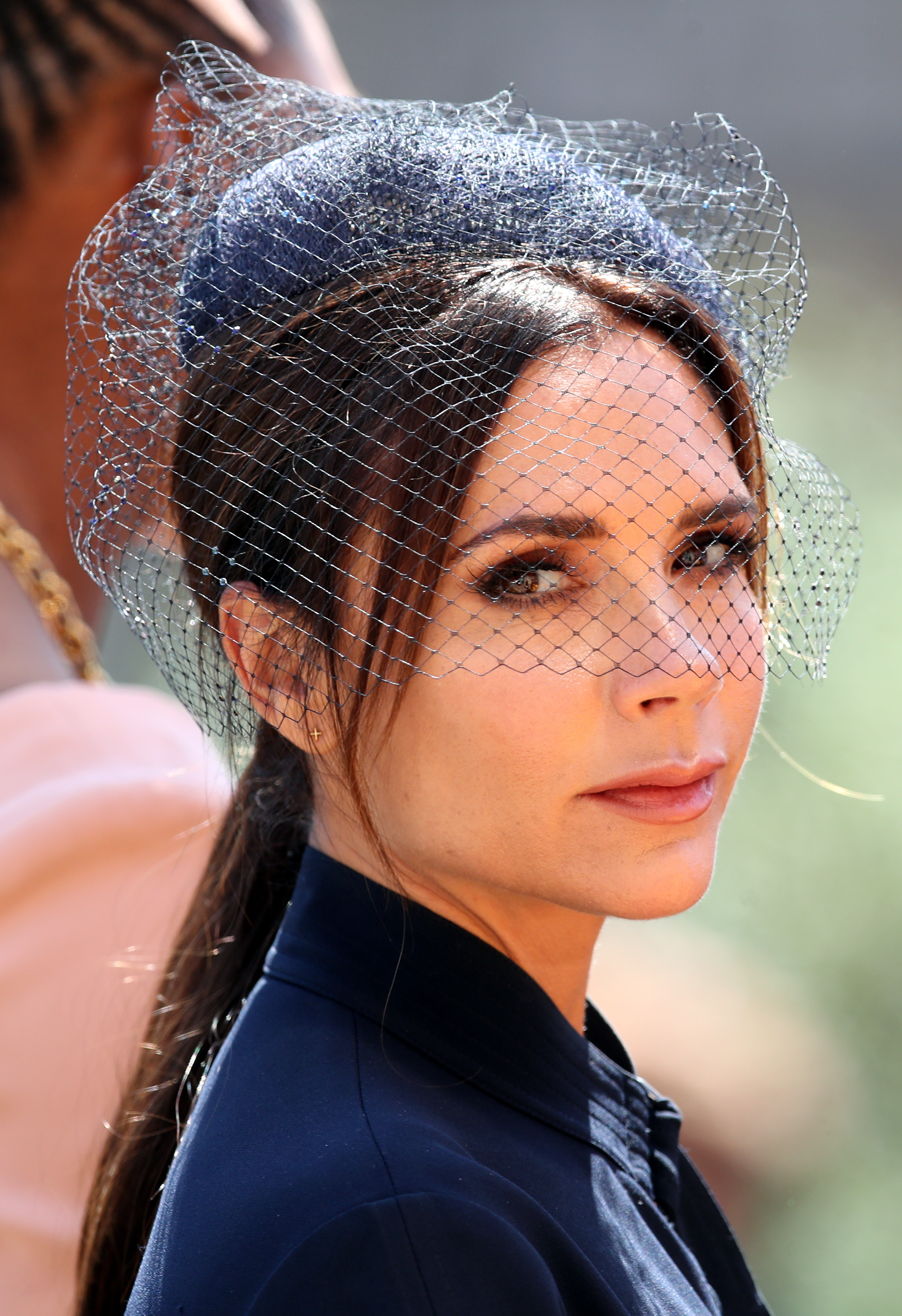 Victoria Beckham wore a navy fascinator positioned on the crown of her head  to match her navy dress (Chris Radburn PA) d05f9e8779c