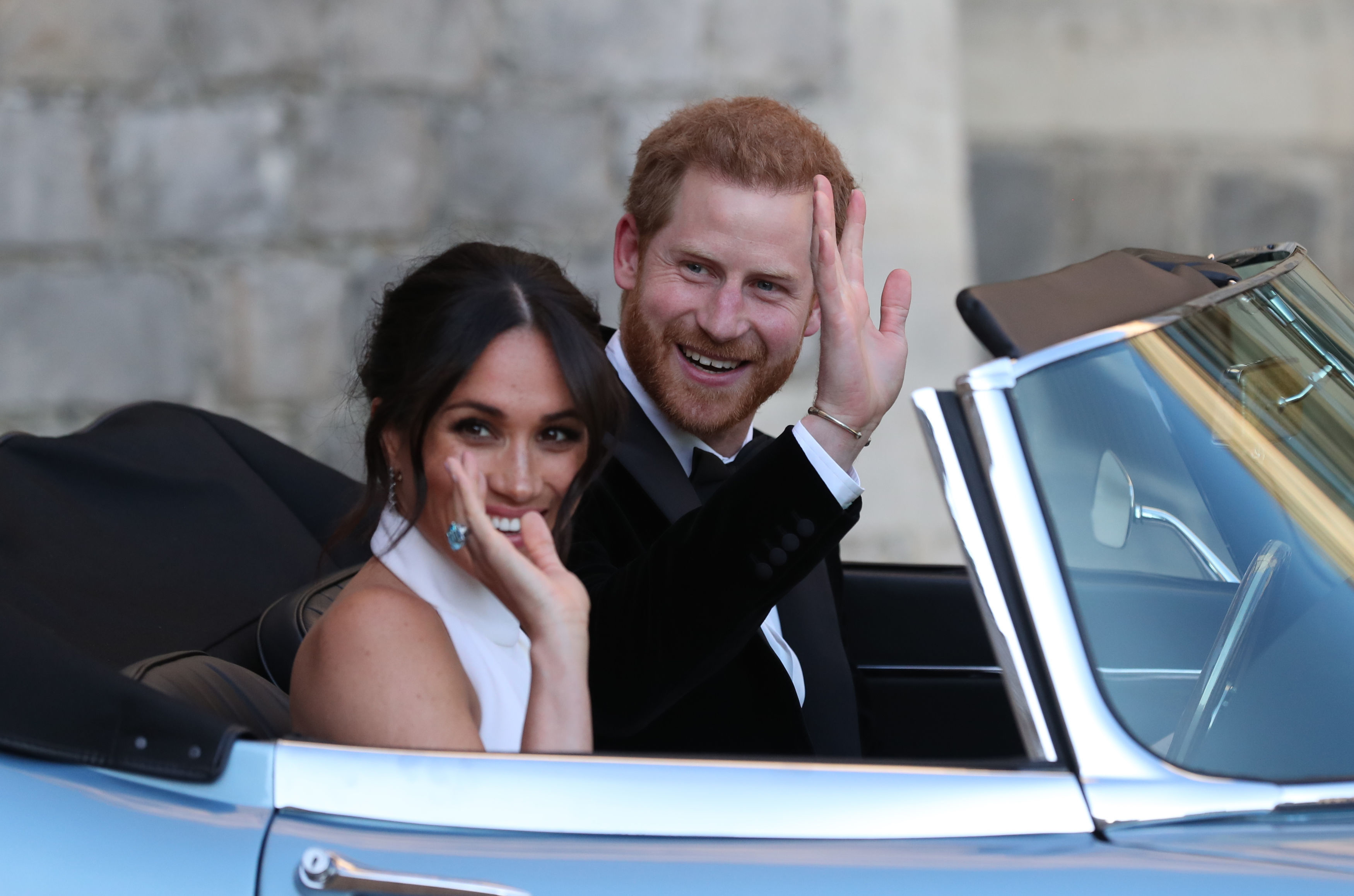 The newly married Duke and Duchess of Sussex, Meghan Markle and Prince Harry, leaving Windsor Castle after their wedding to attend an evening reception at Frogmore House, hosted by the Prince of Wales. (Steve Parsons/PA)