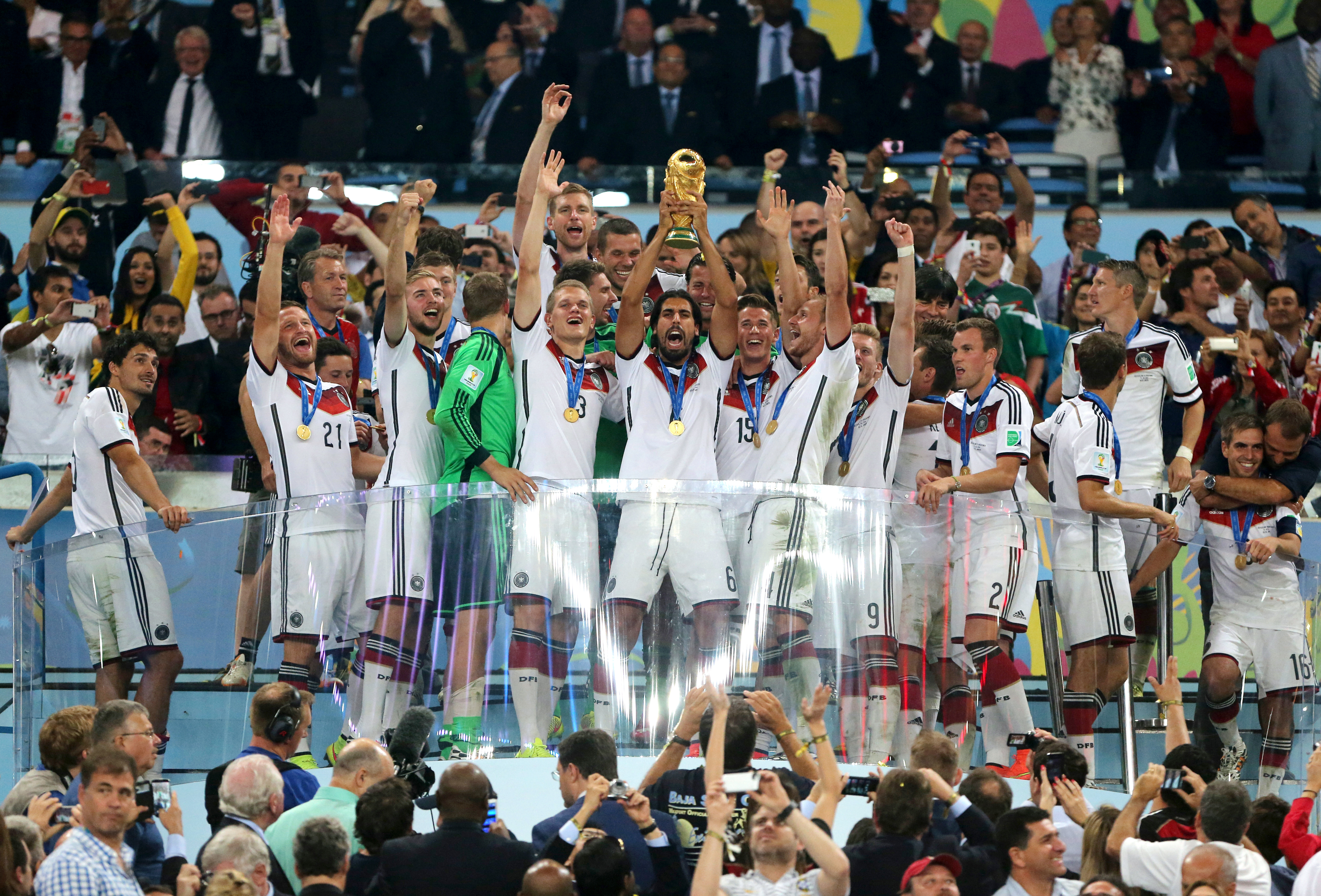 Germany's Sami Khedira lifts the World Cup trophy