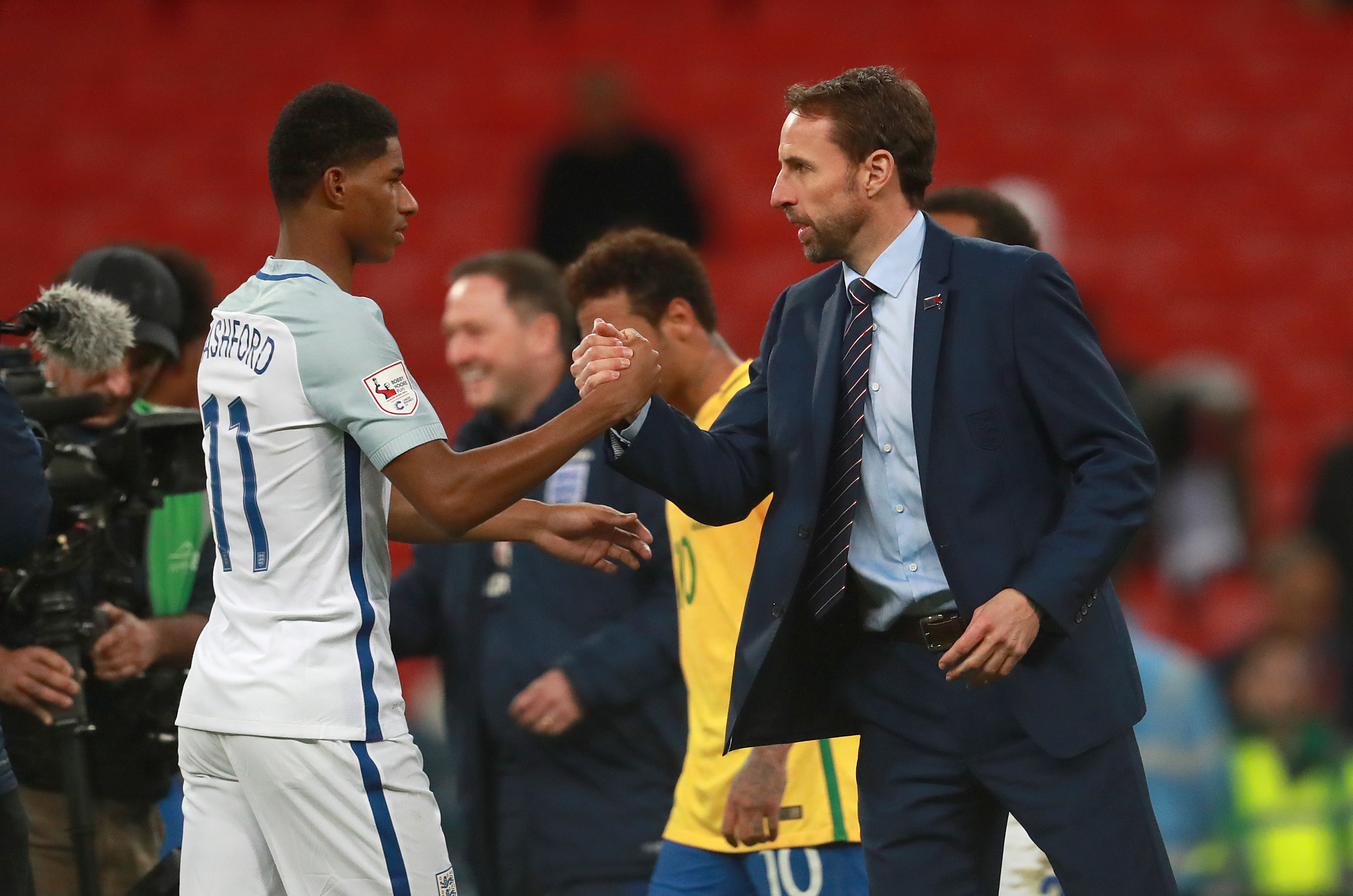 England's Marcus Rashford shakes hands with manager Gareth Southgate
