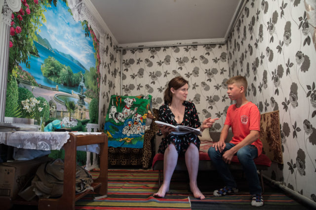 Sophie Ellis-Bextor meets a boy in Moldova who charity Lumos recused from an orphanage.