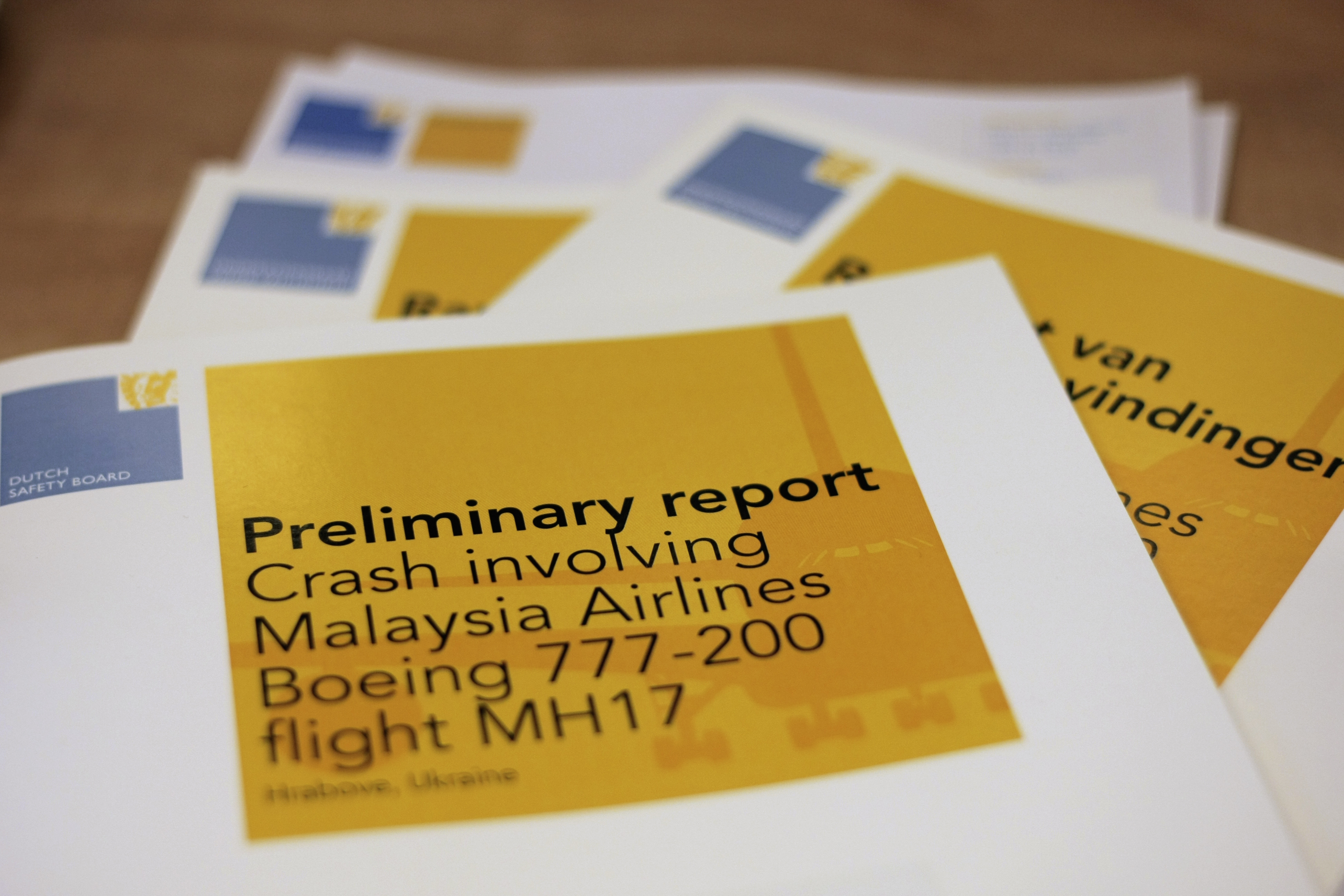 A stack of preliminary reports by the Dutch Safety Board on the crash of Malaysia Airlines flight MH17 in 2014 (Mike Corder/AP)