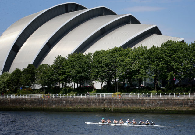 The crew of the women's eight from the University of Edinburgh pass beneath the Armadillo on the River Clyde in Glasgow )Jane Barlow/PA)