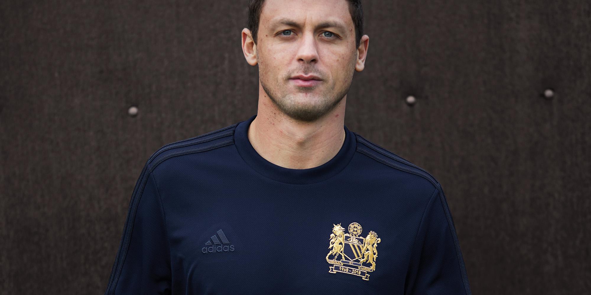 5753aa72dc1 Manchester United midfielder Nemanja Matic in a commemorative United top