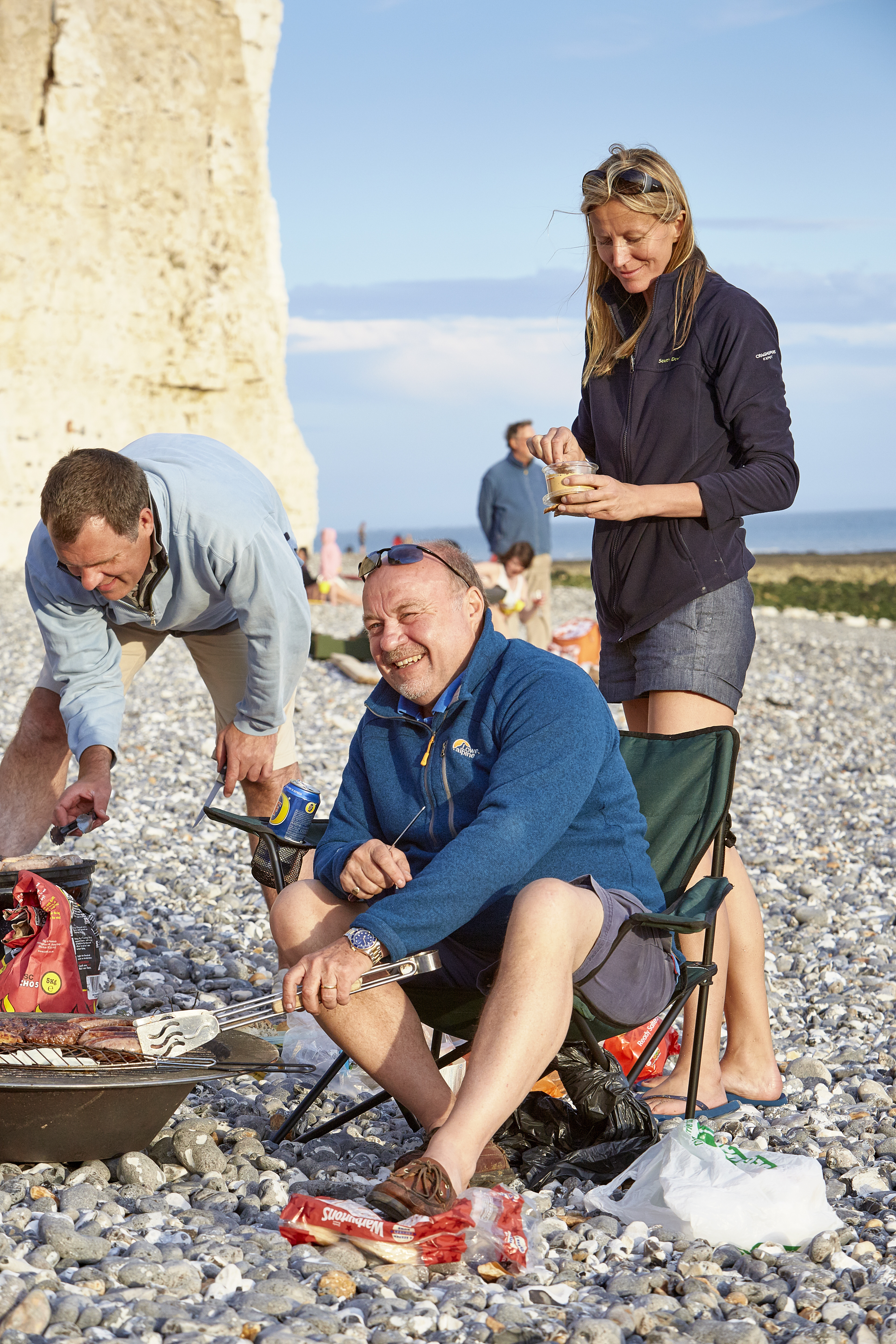 Visitors cooking food on the beach at Birling Gap and the Seven Sisters, East Sussex. Stretching between Birling Gap and Cuckmere Haven are the world-famous Seven Sisters chalk cliffs.